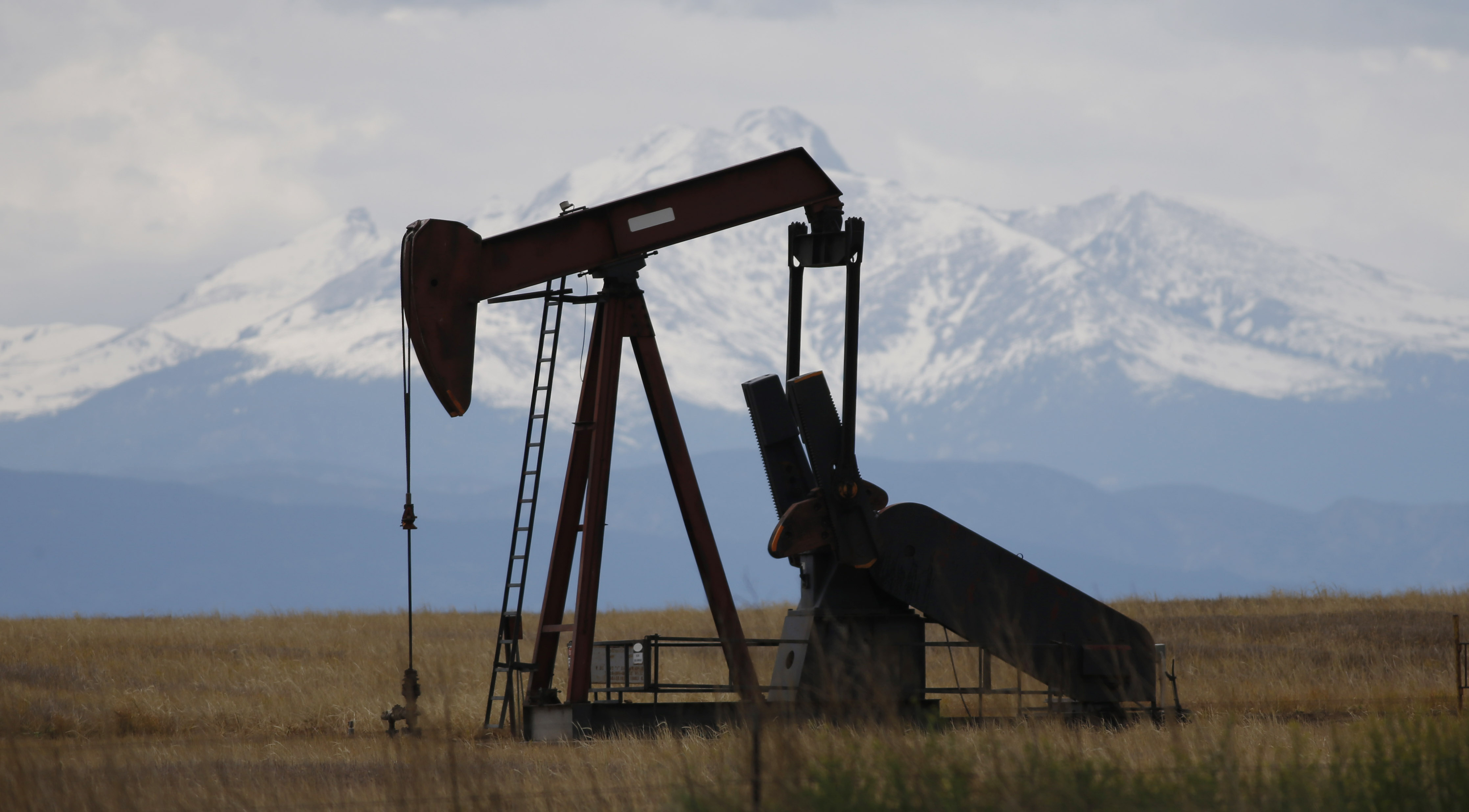 <p>In thisMay 2016, photograph, a pump jack works off state Highway 119 near Firestone, Colo.</p>