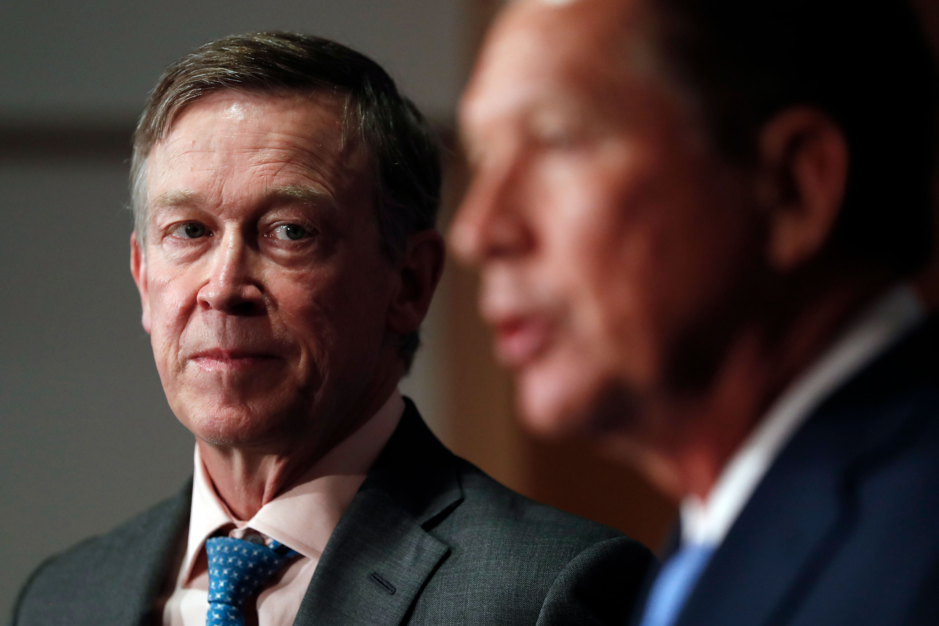 <p>Colorado Gov. John Hickenlooper looks to Ohio Gov. John Kasich as he speaks about overhauling health care at the National Press Club in Washington, D.C., Tuesday, June 27, 2017.</p>
