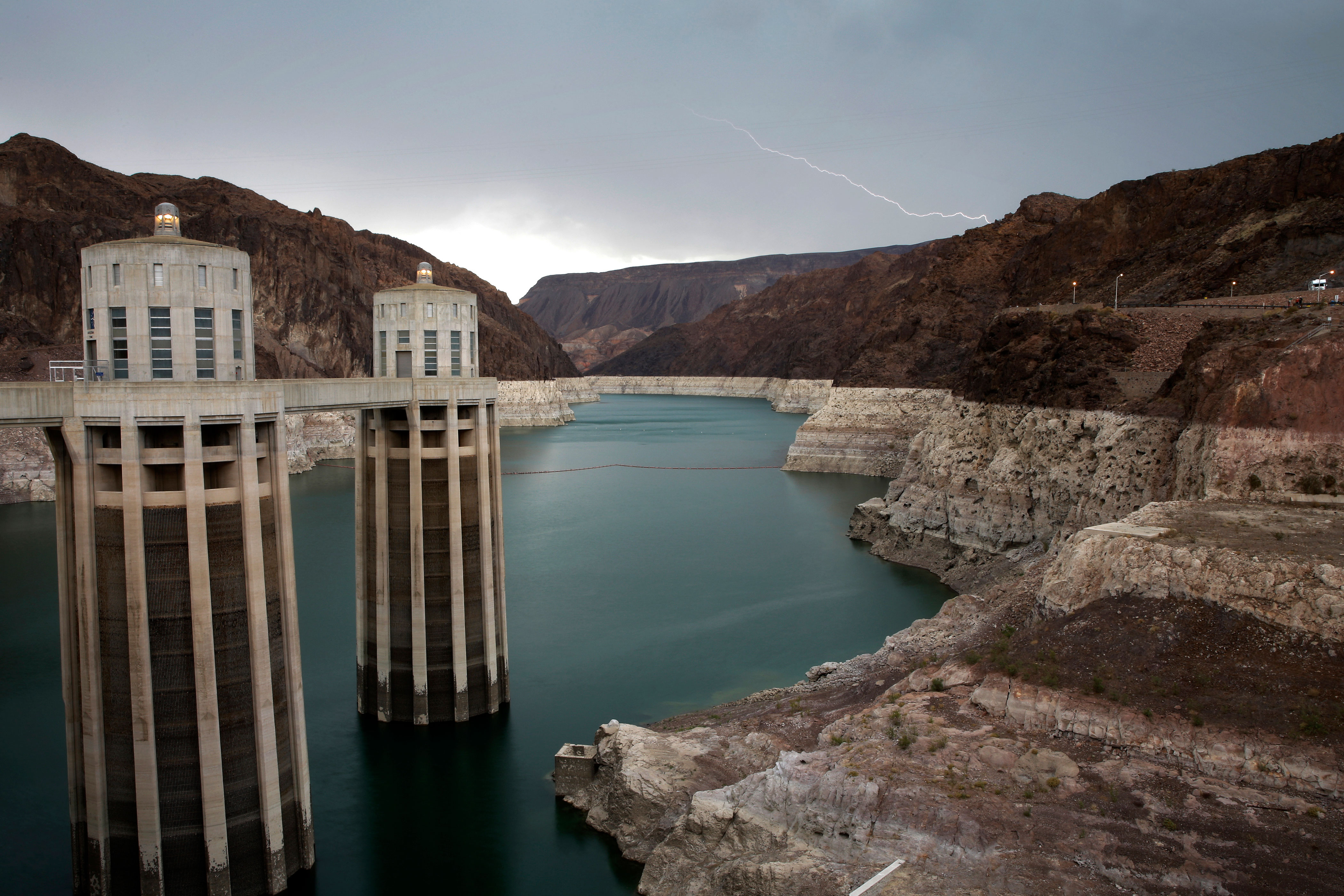 <p>Lightning strikes over a very low Lake Mead near Hoover Dam at the Lake Mead National Recreation Area in Arizona, July 28, 2014.</p>