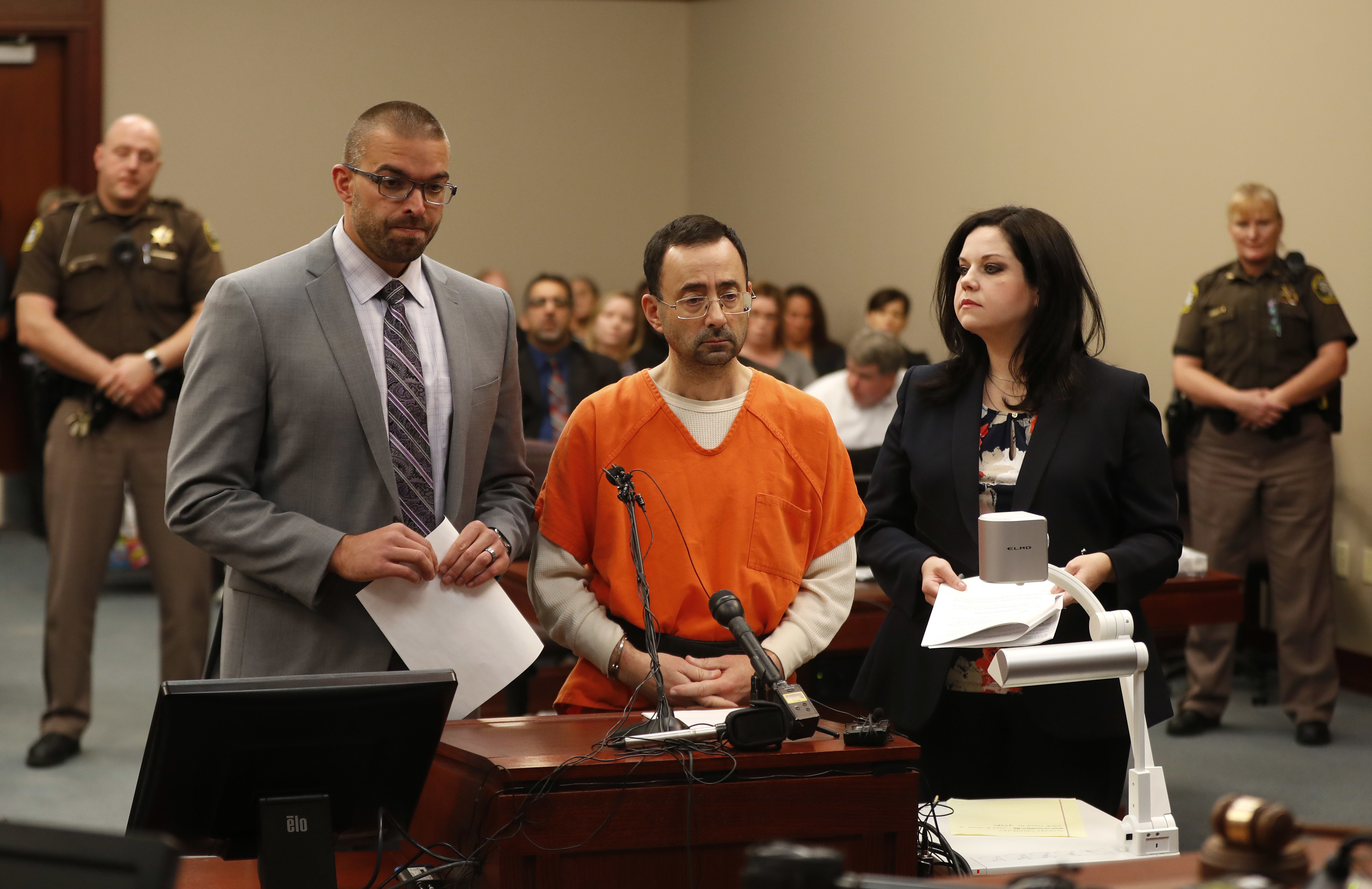 Dr. Larry Nassar, 54, appears in court for a plea hearing inMichigan on Nov. 22, 2017. Nassar, a sports doctor accused of molesting girls while working for USA Gymnastics and Michigan State University, pleaded guilty to multiple charges of sexual assault and will face at least 25 years in prison.