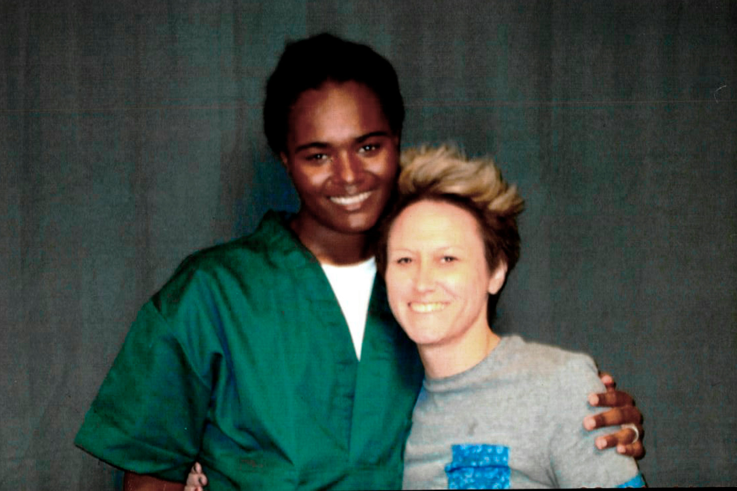 This 2018 photo provided by inmate Lindsay Saunders-Velez shows her, at left, with mentor Meghan Baker at the Colorado Territorial Correctional Facility in Cañon City, Colo.