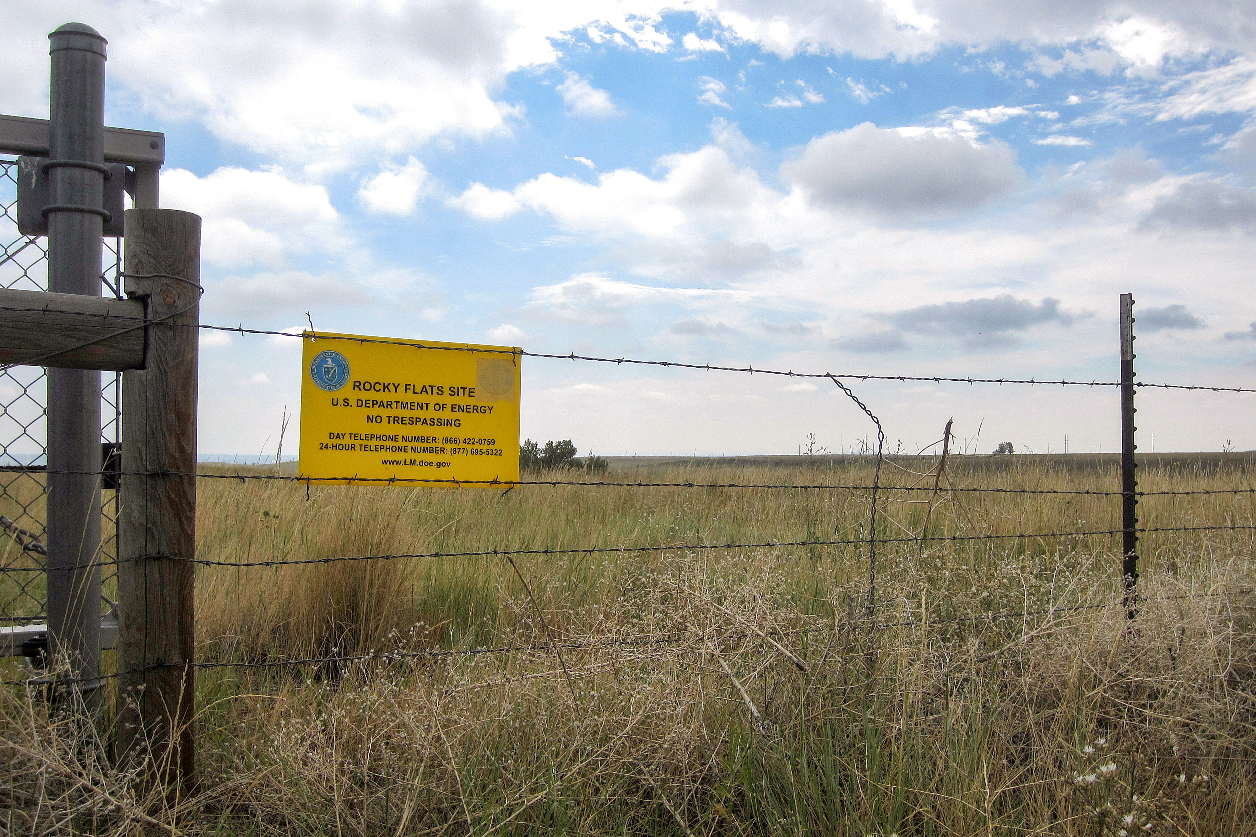 """<p>A """"no trespassing"""" sign hanging on a fence surrounding part of the former Rocky Flats nuclear weapons plant near Denver, Aug. 11, 2017. Part of the site was designated a refuge after a $7 billion cleanup, but the area where plutonium was handled remains off-limits.</p>"""