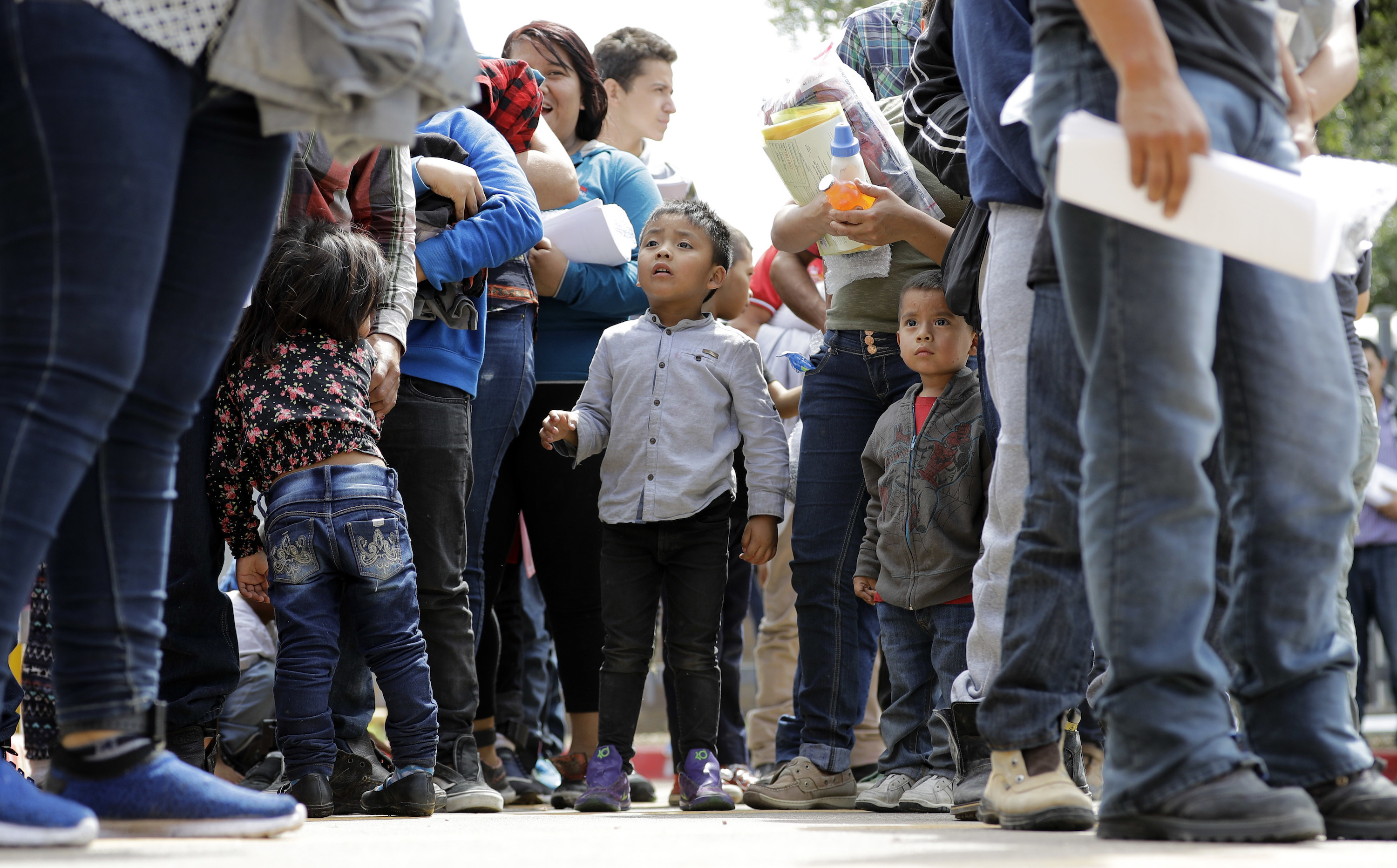 <p>Immigrant families line up to enter the central bus station after they were processed and released by U.S. Customs and Border Protection, Sunday, June 24, 2018, in McAllen, Texas.</p>