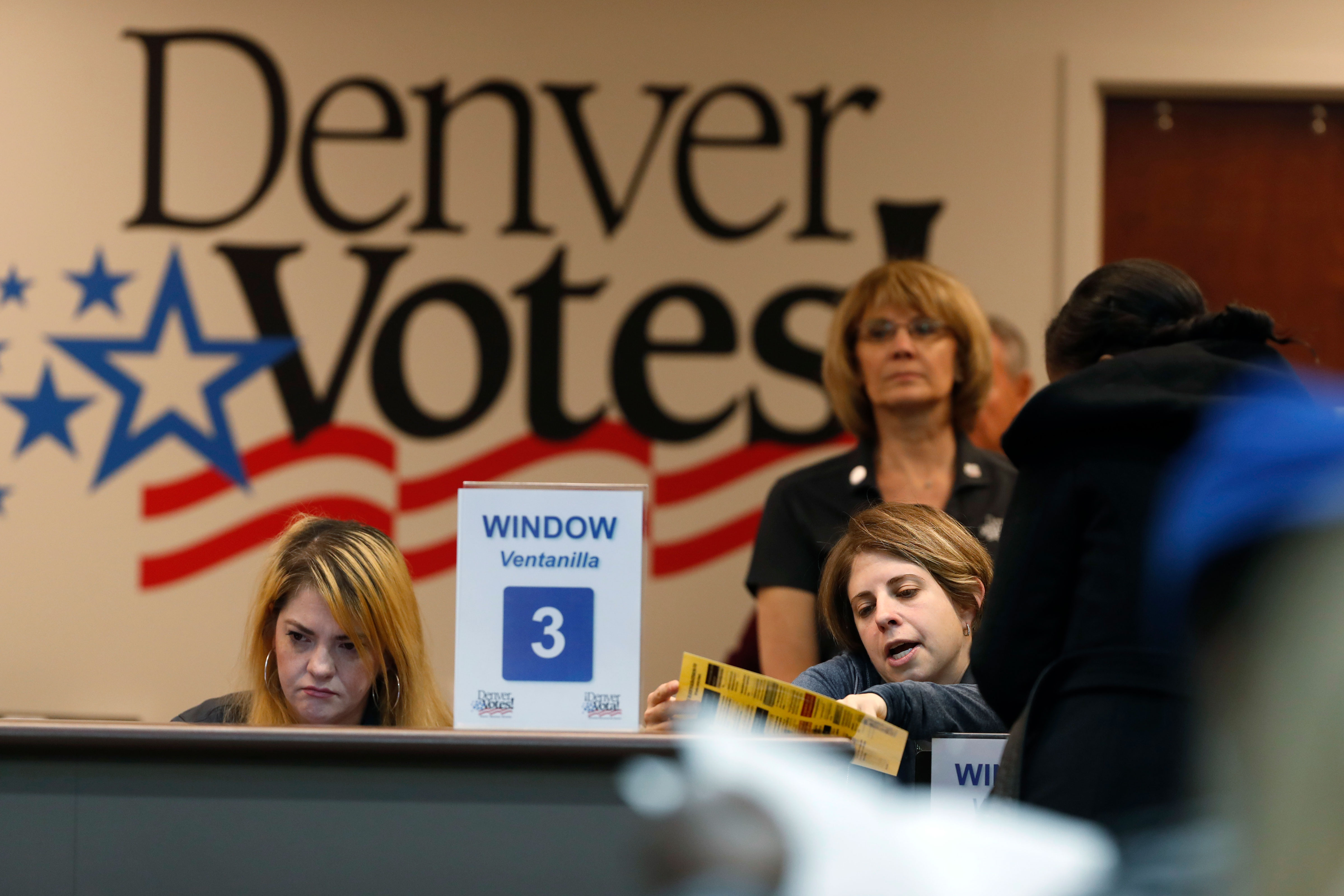 <p>An election judge helps a voter with a question about the ballot at the Denver Elections Division Tuesday, Nov. 6, 2018, in Denver.</p>