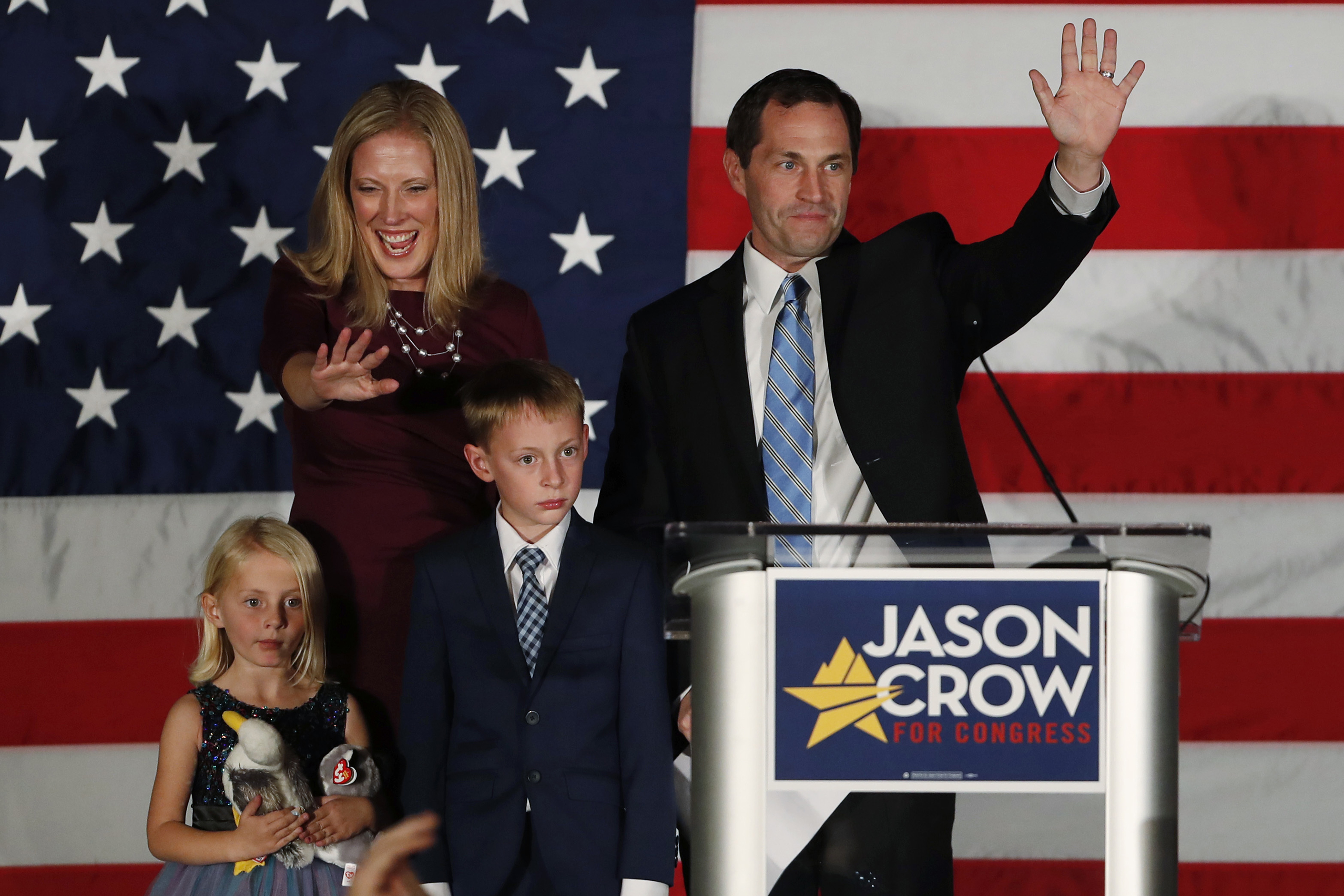 <p>Jason Crow, his wife Deserai, back left, and their 5-year-old daughter Josephine, front right, and 8-year-old son Anderson in greet supporters Tuesday, Nov. 6, 2018, during an election night watch party in Greenwood Village, Colo. Crow defeated Republican incumbent Mike Coffman to win 6th Congressional District seat.</p>