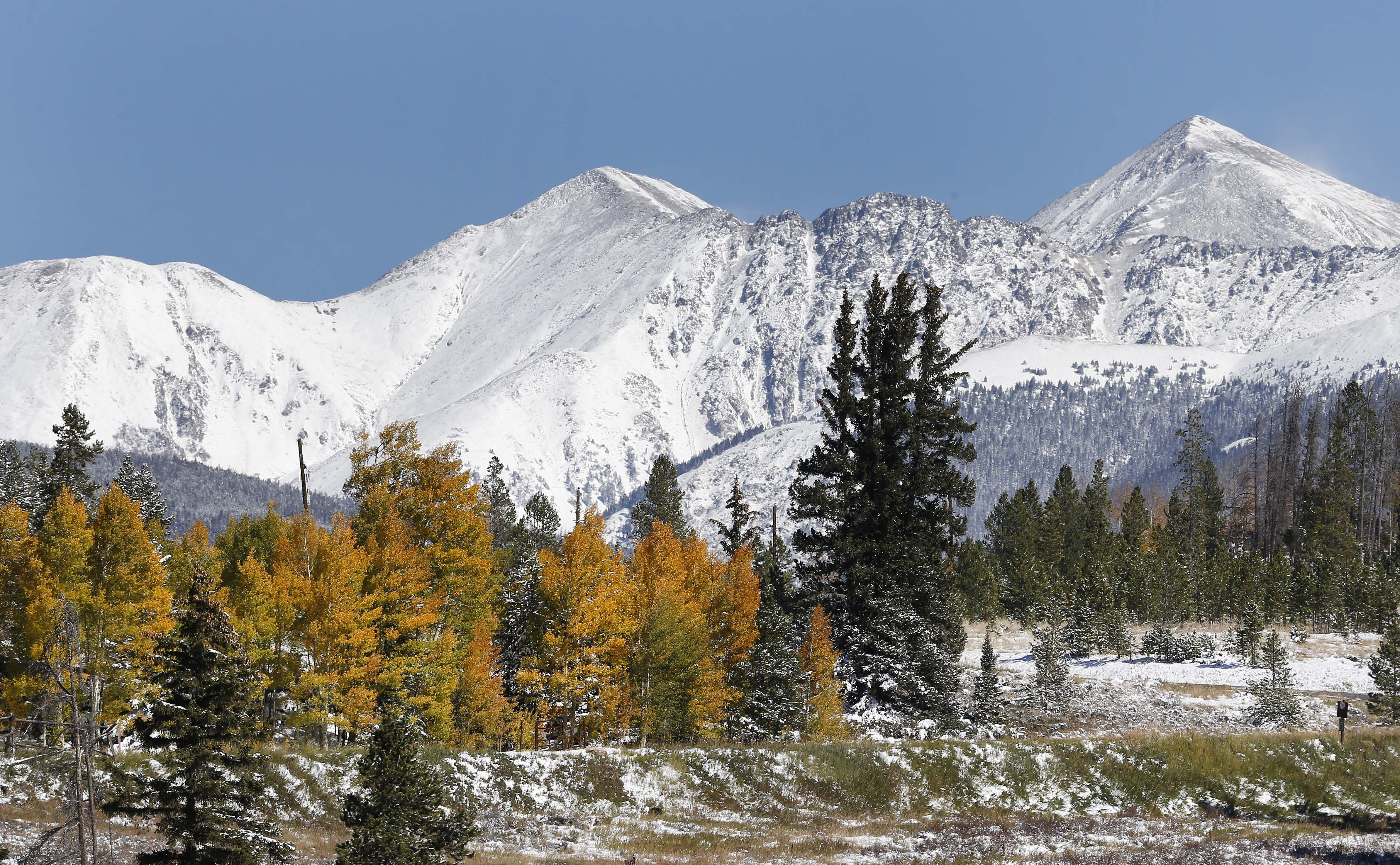 <p>Fresh snow covers the mountain peaks east of Frisco, Colo., Saturday Oct. 5, 2013.</p>