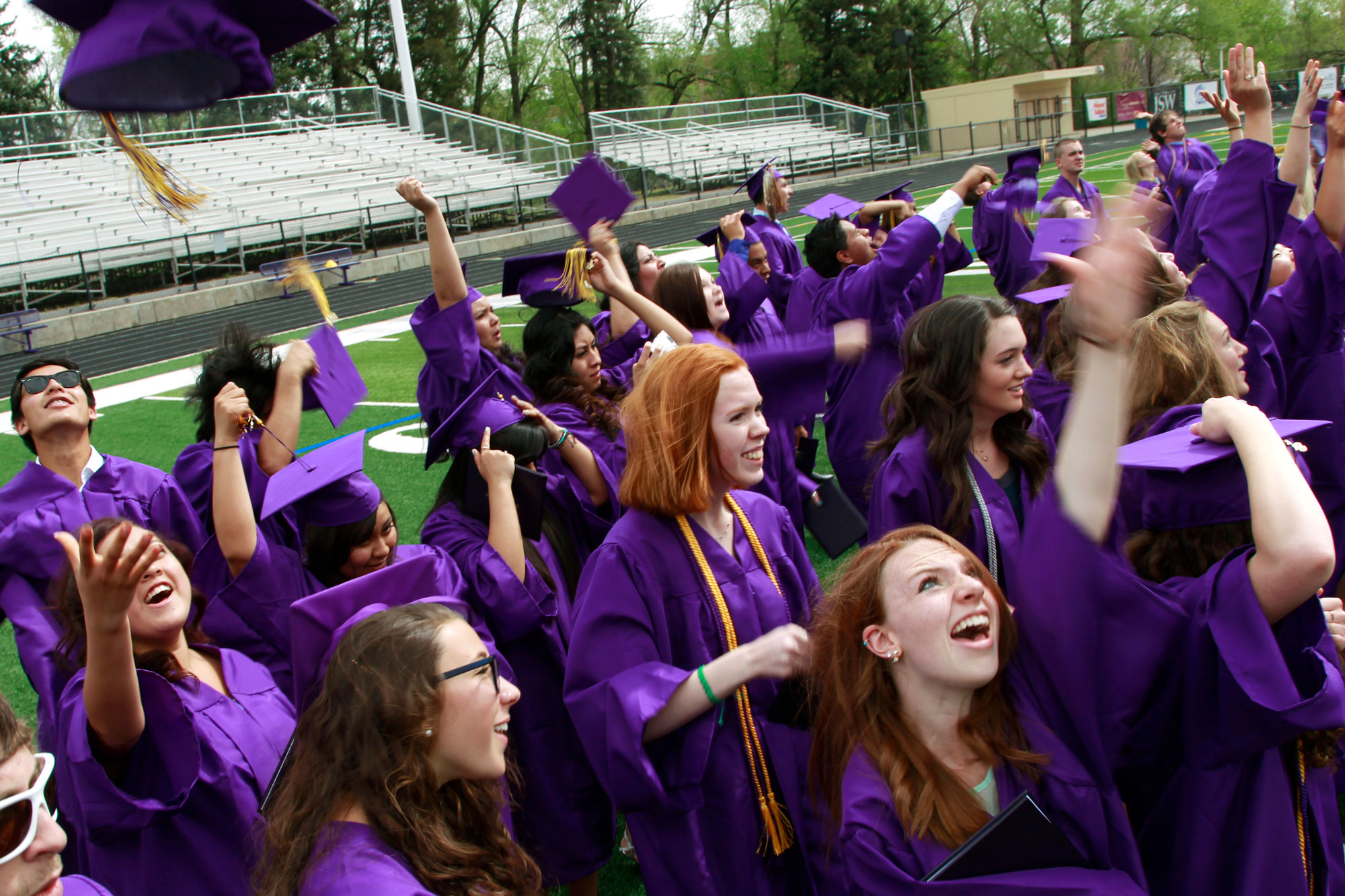 Graduates throw their mortarboards into the air in celebration after receiving their diplomas, following the commencement ceremony at Boulder High School, in Boulder, Colo. on Saturday May 18, 2013.