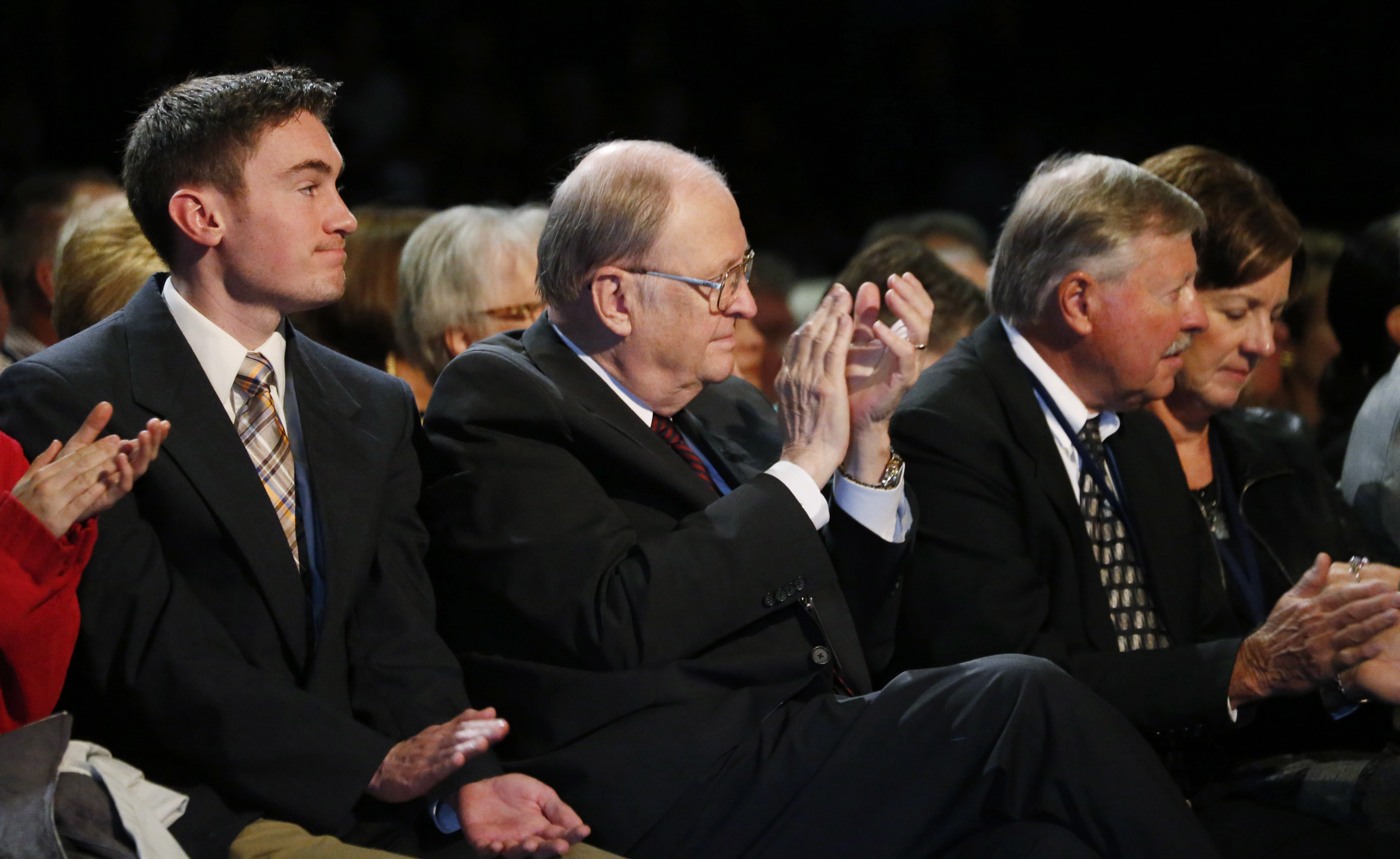 <p>Former U.S. Sen. Bill Armstrong applauds while listening to Republican presidential candidate Ben Carson on Oct. 29, 2015 at Colorado Christian College in Lakewood.</p>