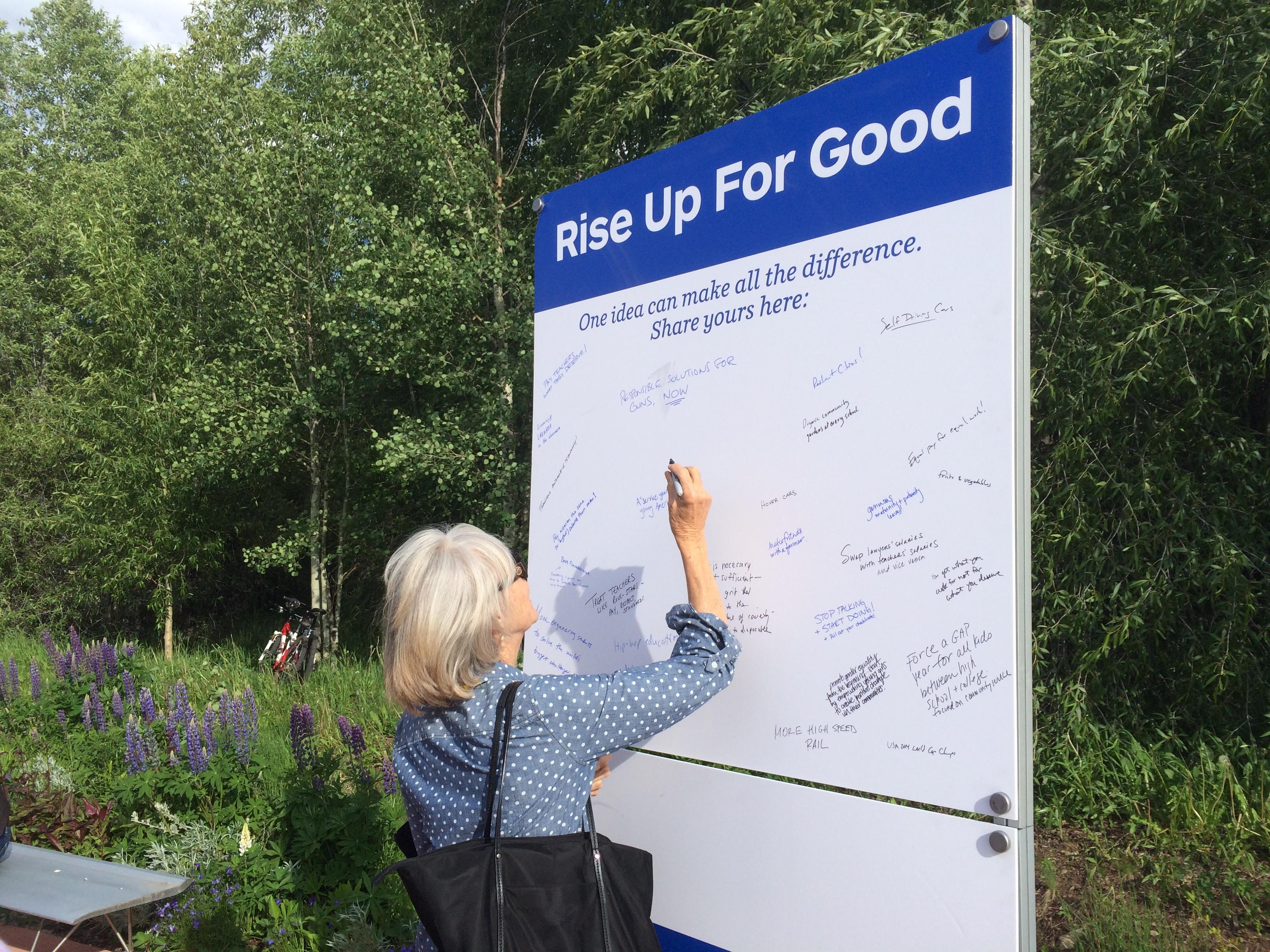 <p>An Aspen Ideas Festival participant jots down an idea on a public message board.</p>
