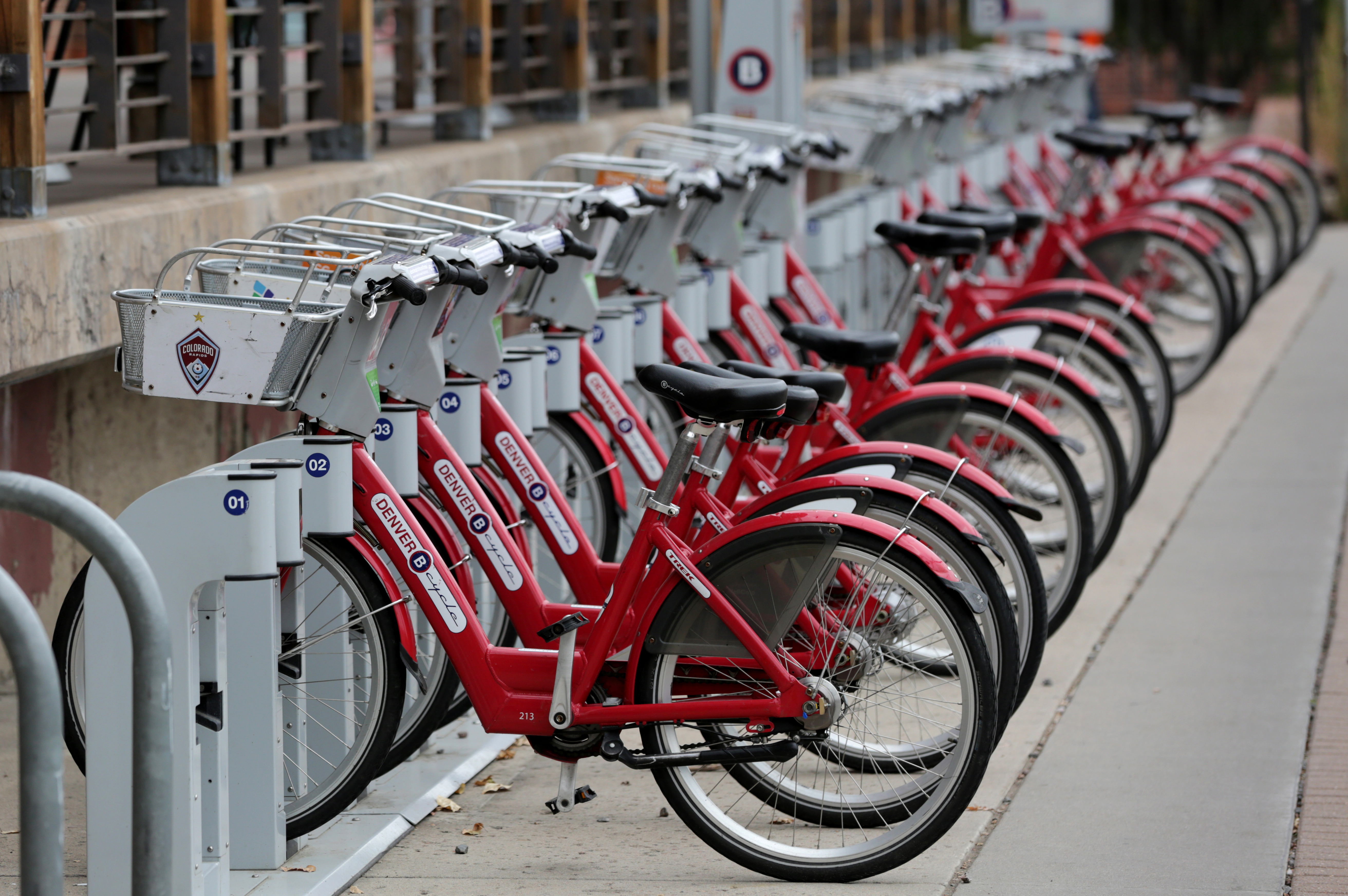 <p>Denver B Cycle bikes parked outside REI in Confluence Park in Denver, Sunday, Oct. 4, 2015.</p>