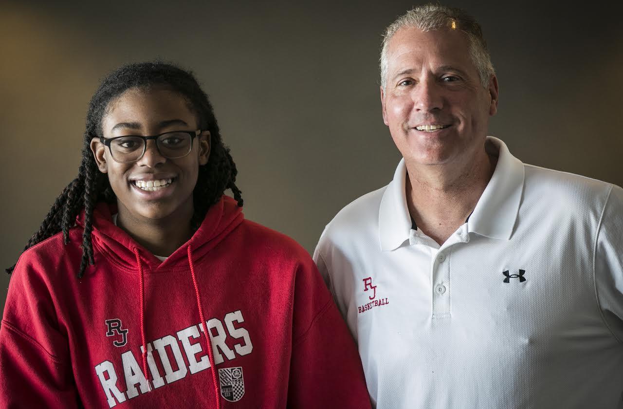 <p>Francesca Belibi, 15-year-old sophomore at Regis Jesuit High School, and Carl Mattei, coach of the Regis girl's basketball team.</p>