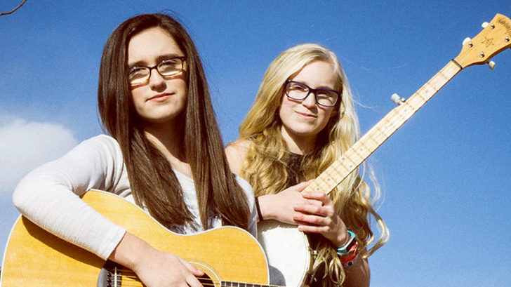 Megan, left, and Maddie, right, of Parker, Colorado. They perform bluegrassas the Cody Sisters.