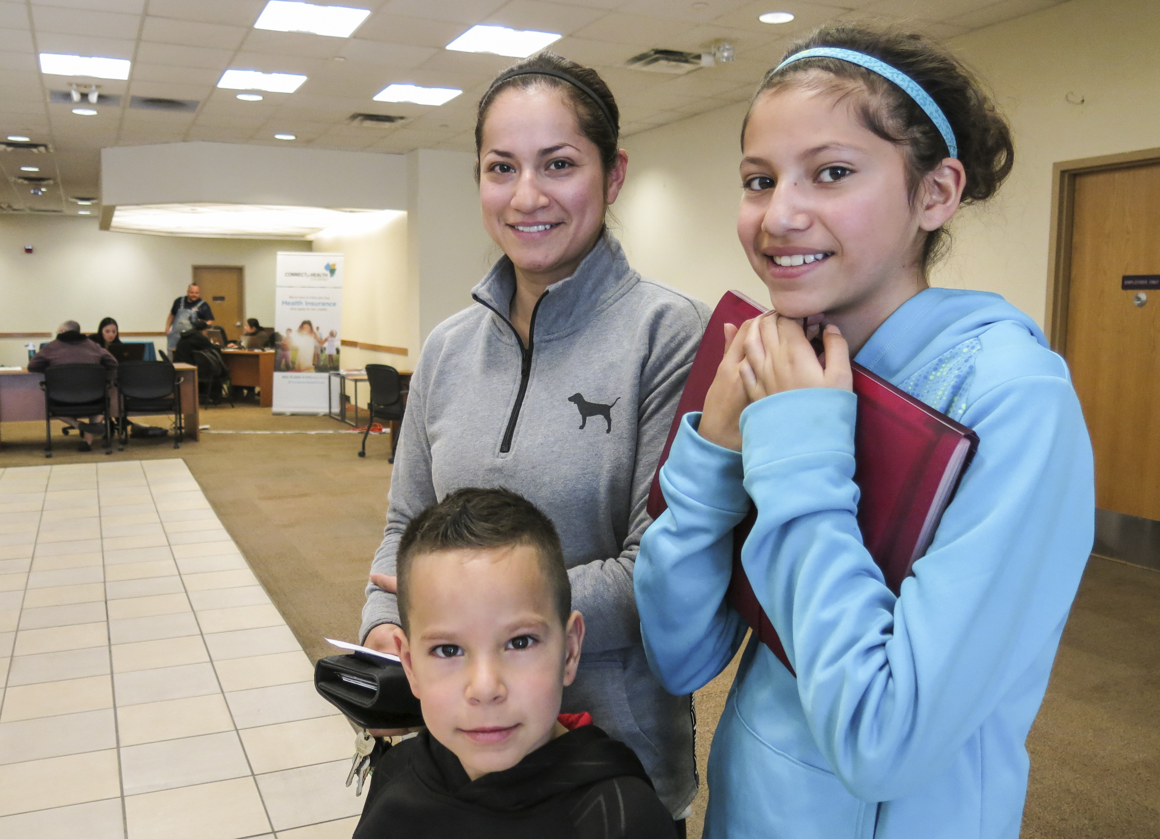 <p>CarmenPerez, a mother from Commerce City, and her children visit the downtown Denver walk-in center for Connect for Health Colorado, the state's health coverage marketplace.</p>