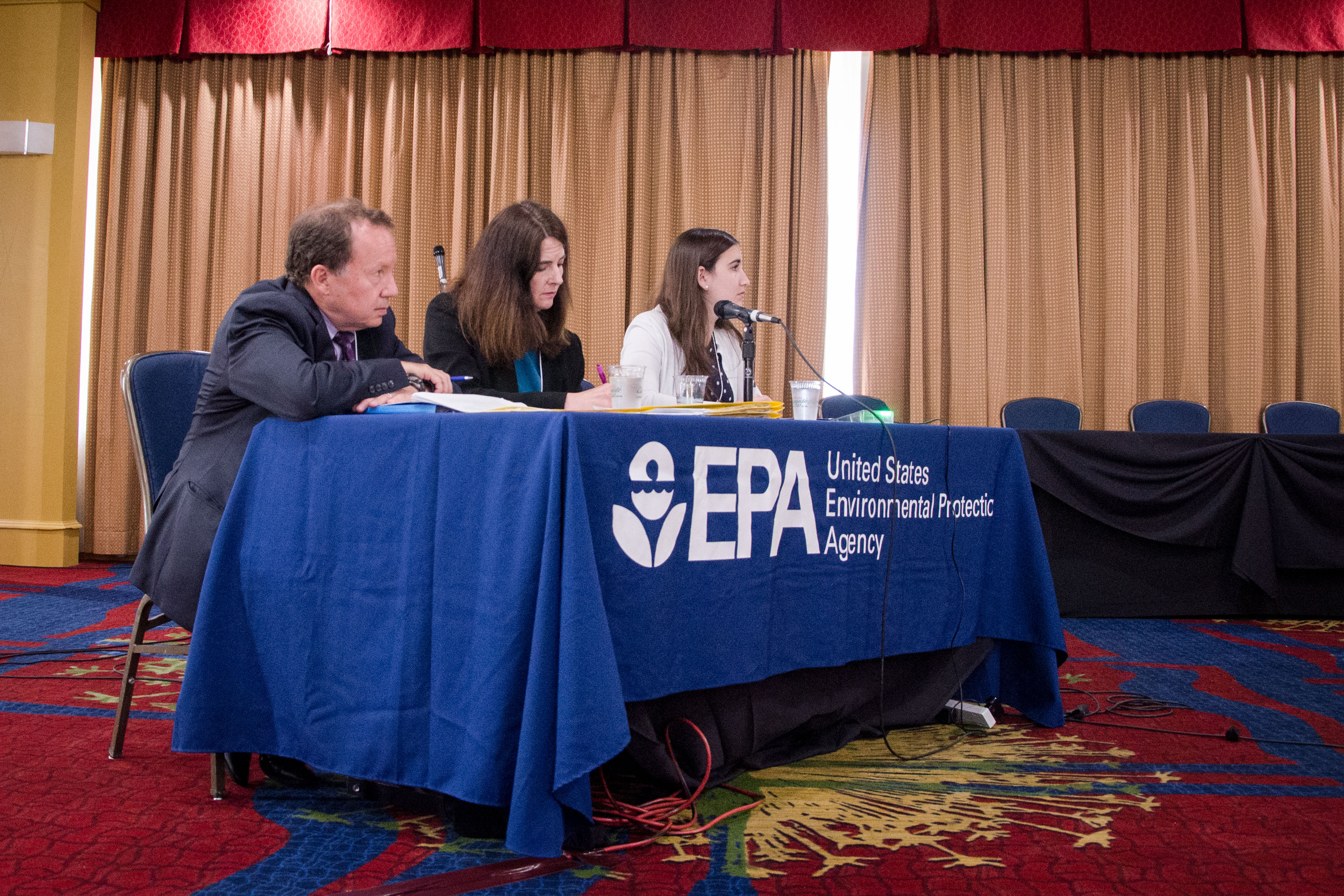 <p>Doug Benevento, regional administrator for EPA's Mountains & Plains Region 8, left, and staff listen to speakers during a PFCs community engagement event in Colorado Springs.</p>