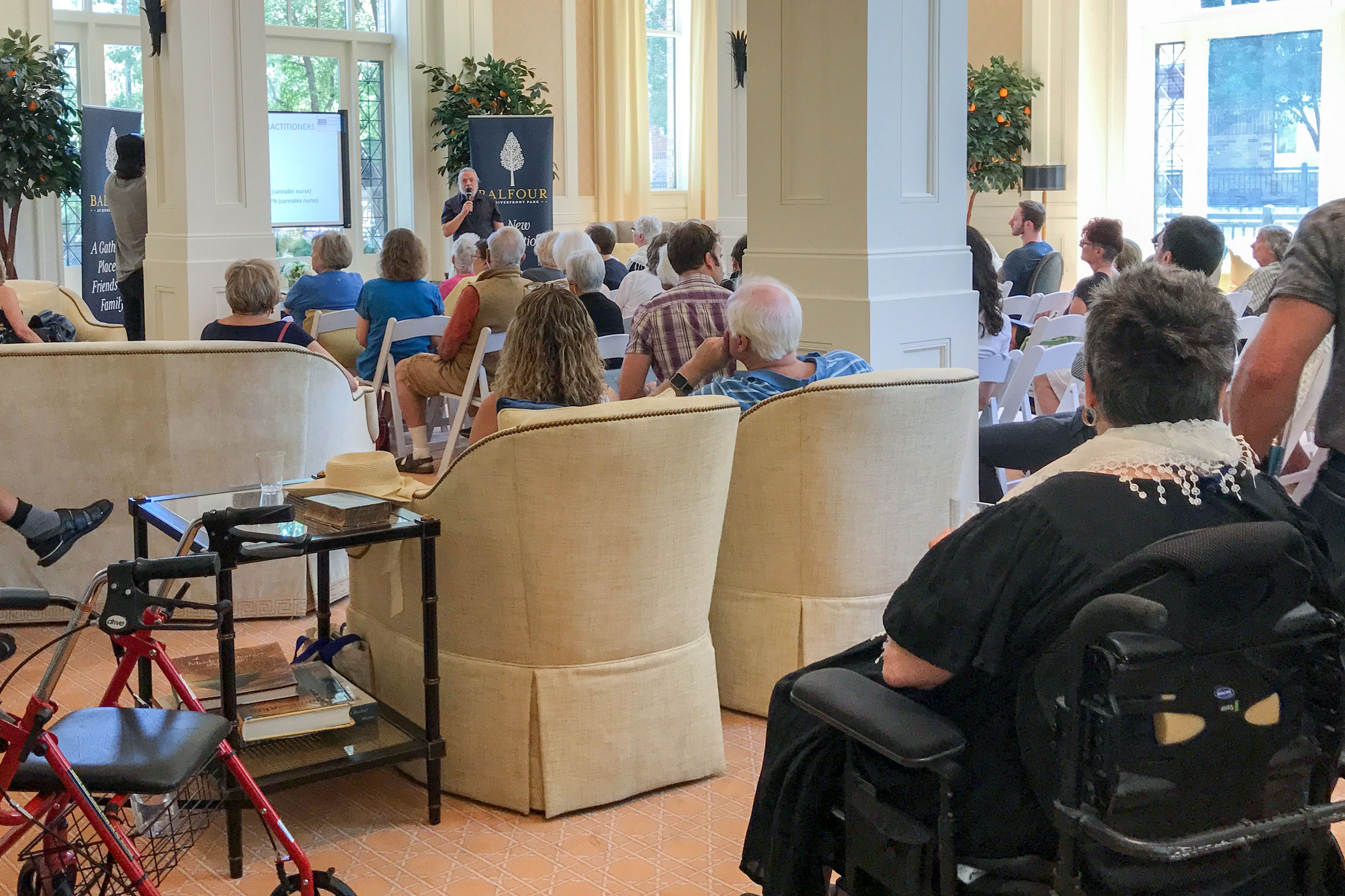"<p>Residents in Balfour's Riverfront Park retirement community in downtown Denver fill the building's spacious lounge to hear Dr. Joe Cohen's seminar, ""Cannabis 101 for Seniors.""</p>"