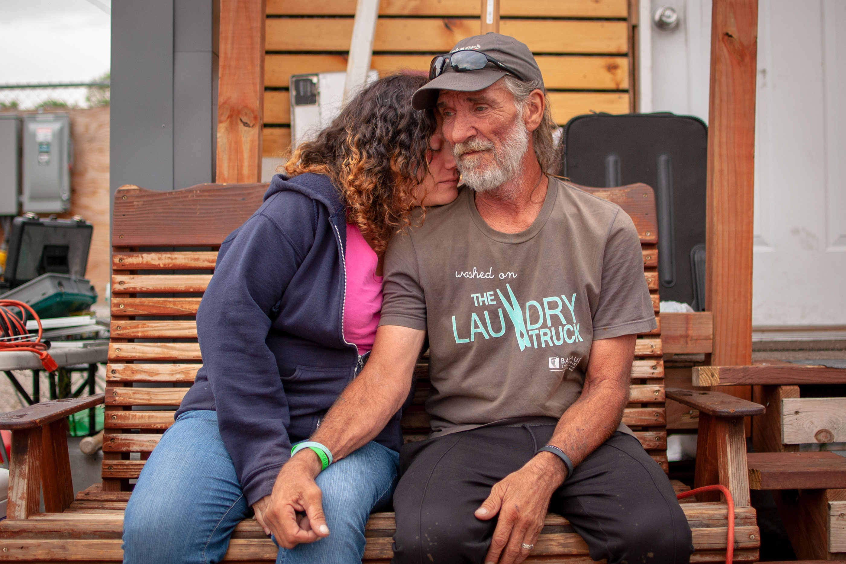 <p>Ray and Amanda Lyall outside their home at the Beloved Community Village in Denver, Colo.</p>