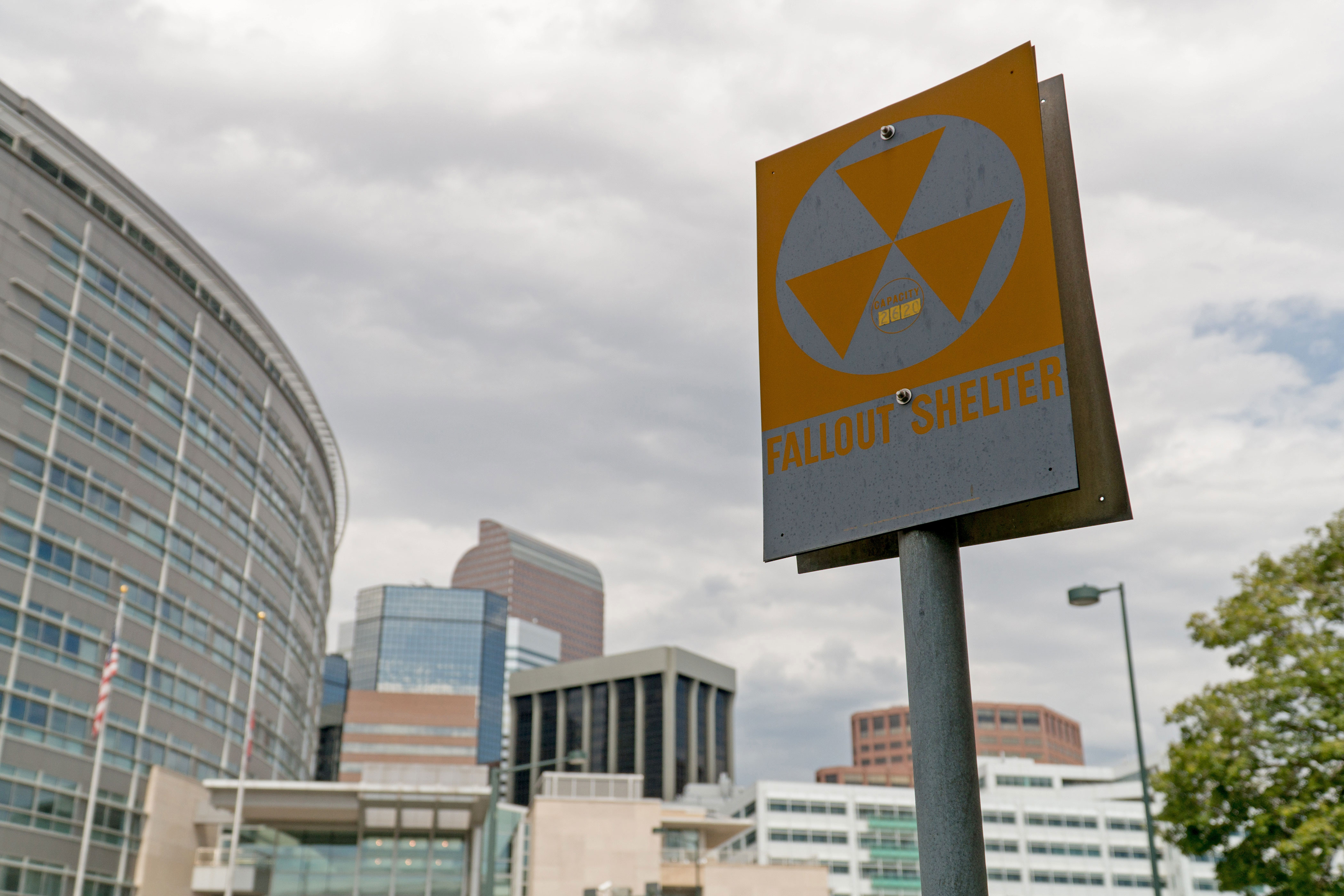 The fallout shelter sign on the north side of the Denver City and County Building, looking back toward downtown along Colfax Avenue.