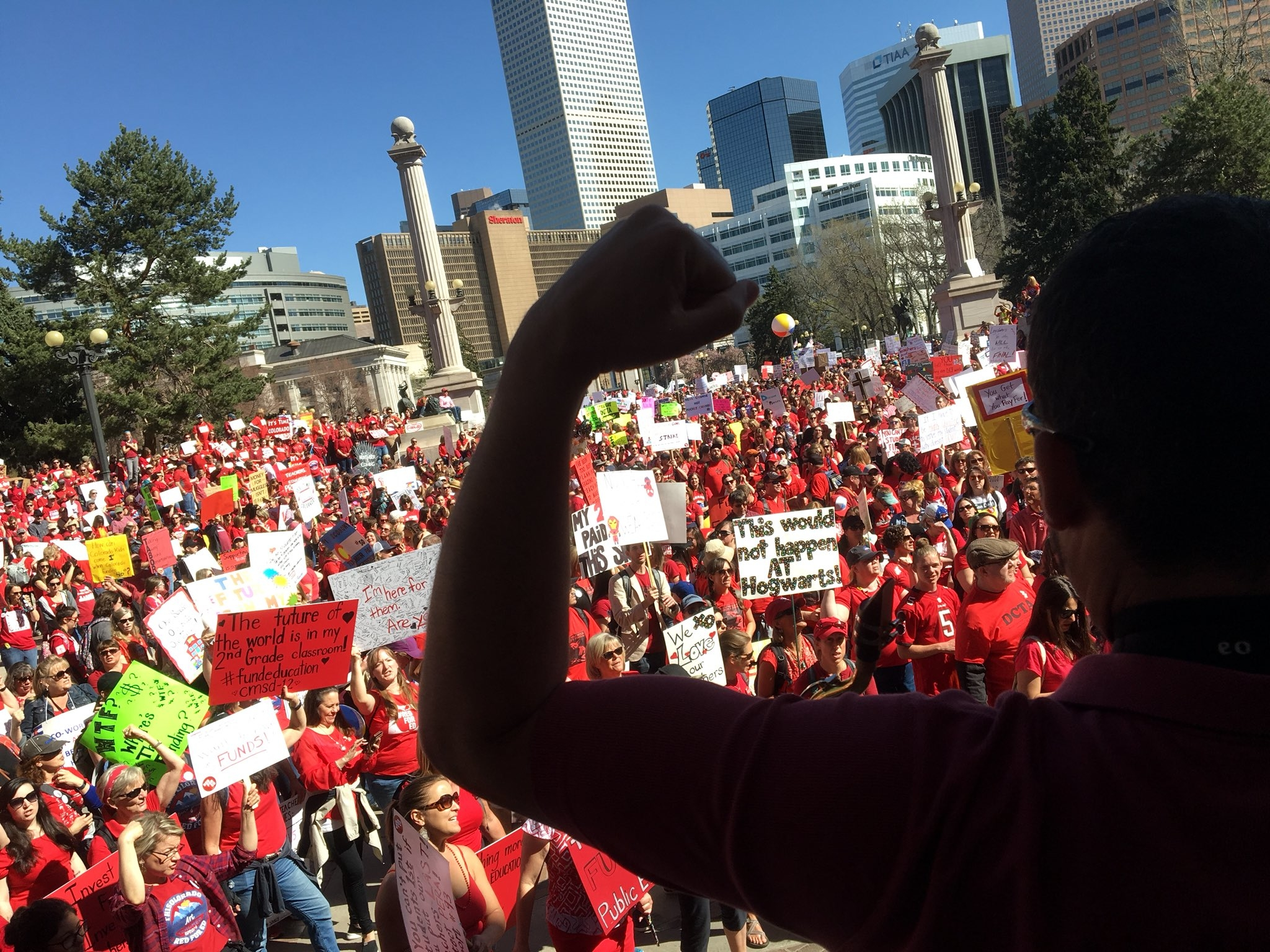 <p>A huge crowd gathered in Civic Center Park in Denver as the Colorado teacher walkout enters day two in April 2018.</p>