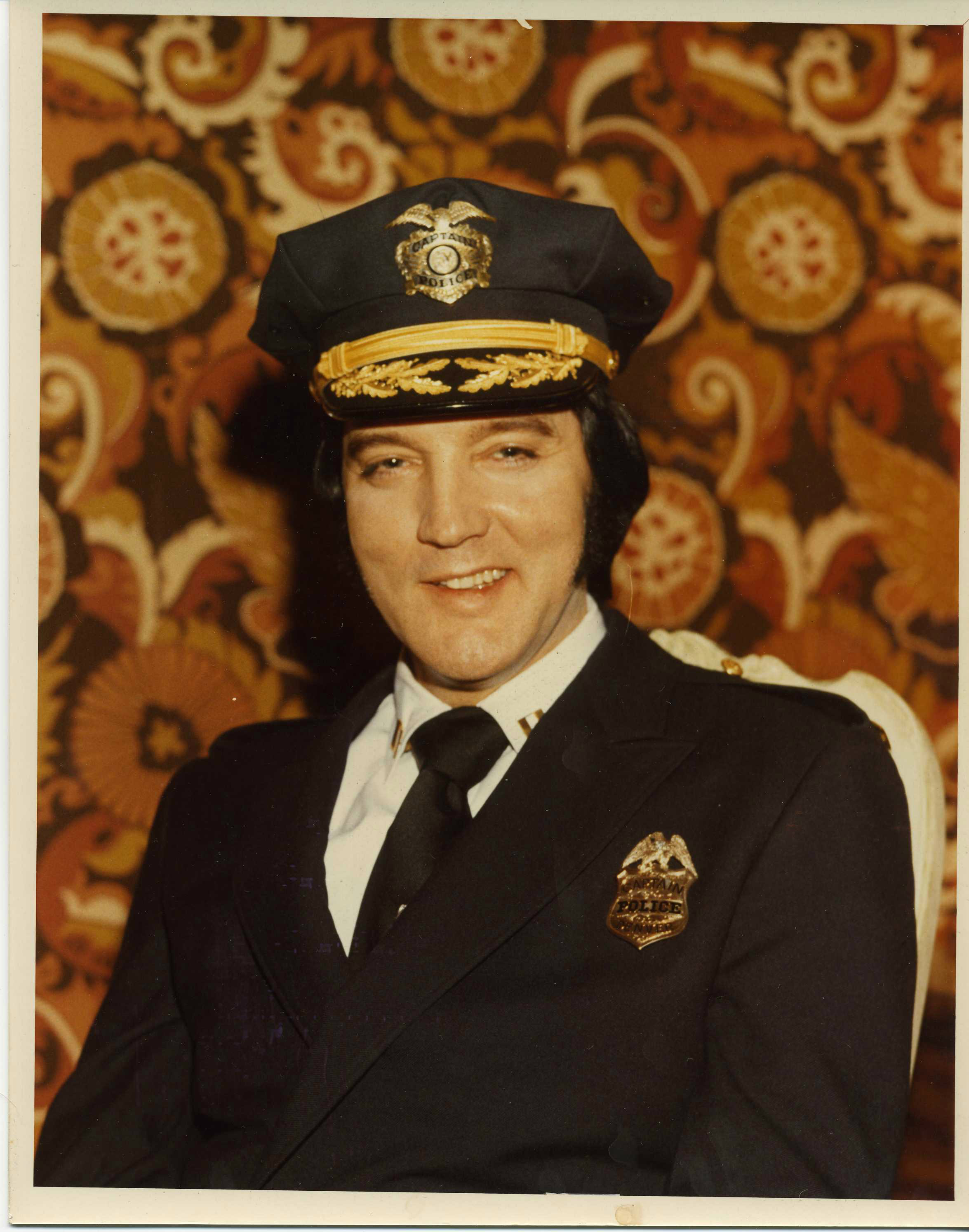 <p>Elvis Presley, as anhonorary captain in the Denver police force.</p>