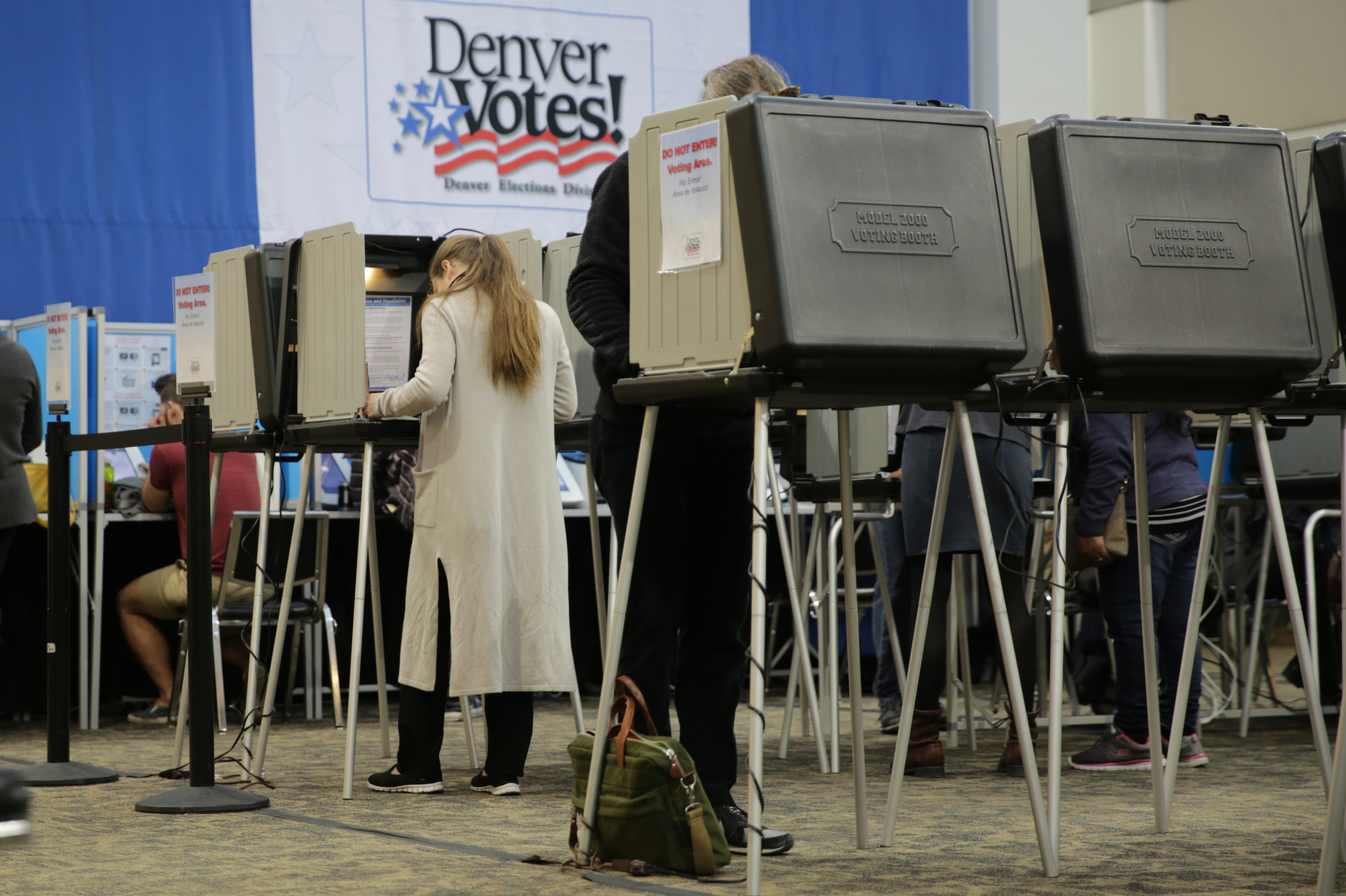<p>Voters casting their ballots at the Denver Elections Division headquarters on Election Day 2016.</p>