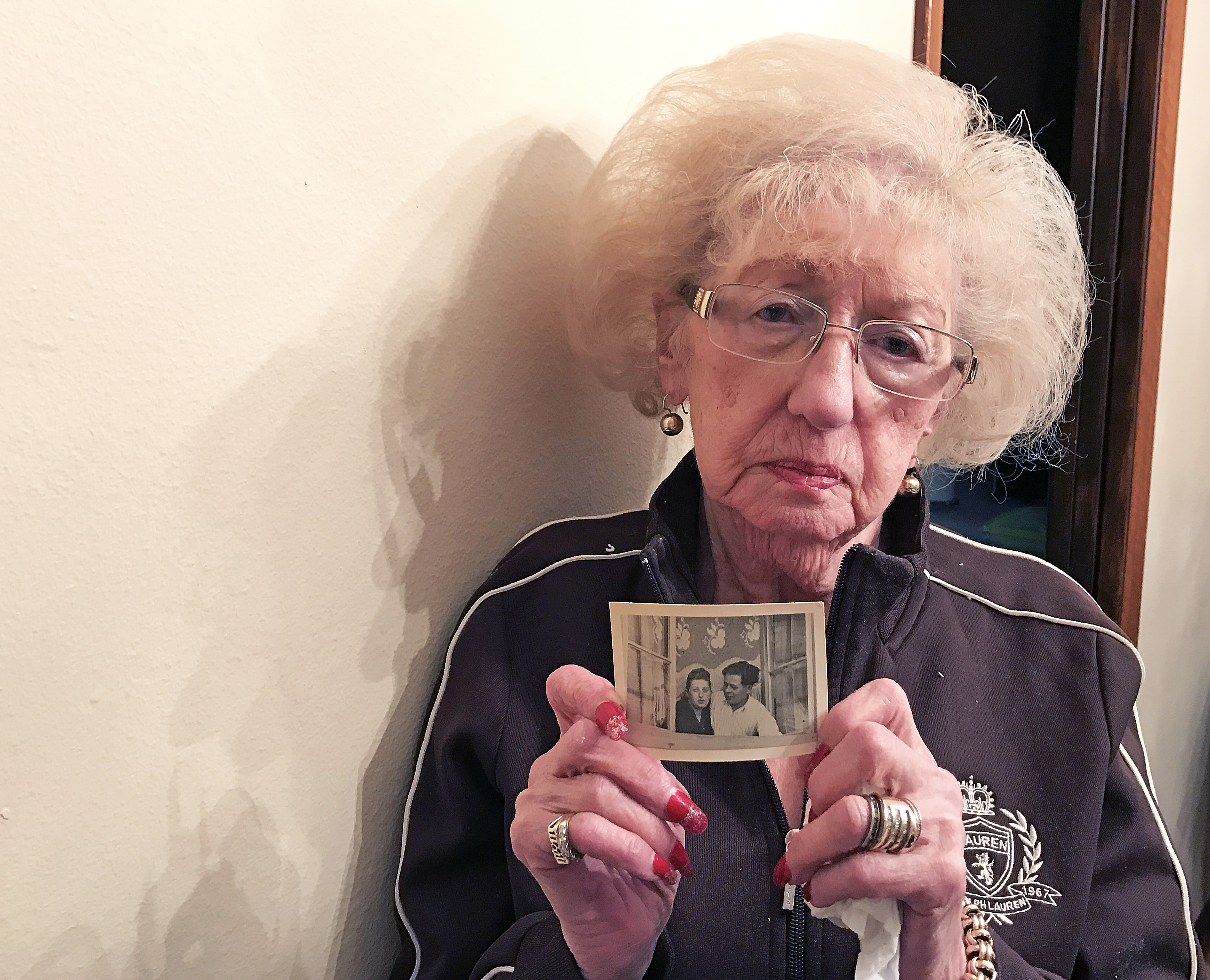 <p>Fanny Starr, of Denver, holds a photo of her and her late husband, Zesa, at her home on March 3, 2017.</p>