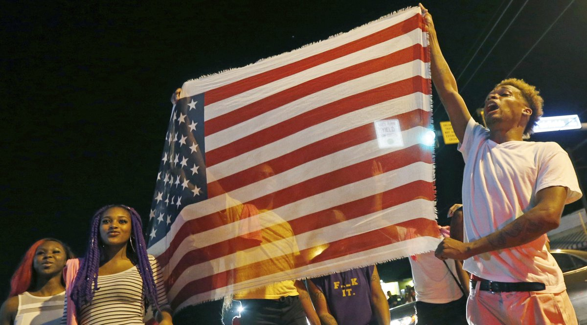 <p>Citizens rally in the aftermath of recent shootings across the country.</p>