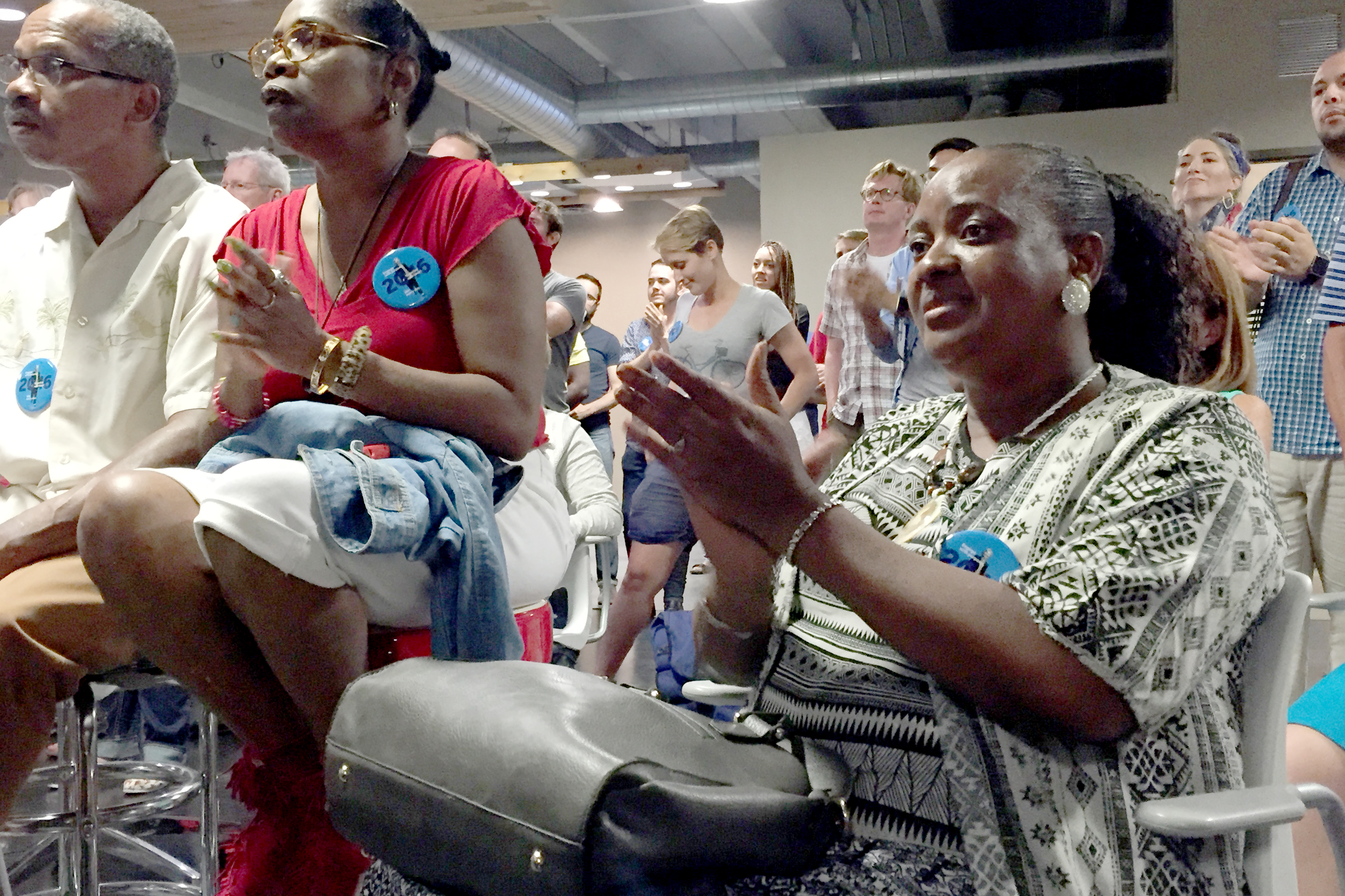Photo: Eunice Walker of Denver and members of her family applaud Hillary Clinton's acceptance speech