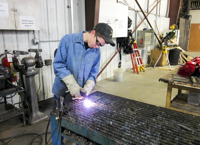 Photo: Common core math agriculture feature student welding
