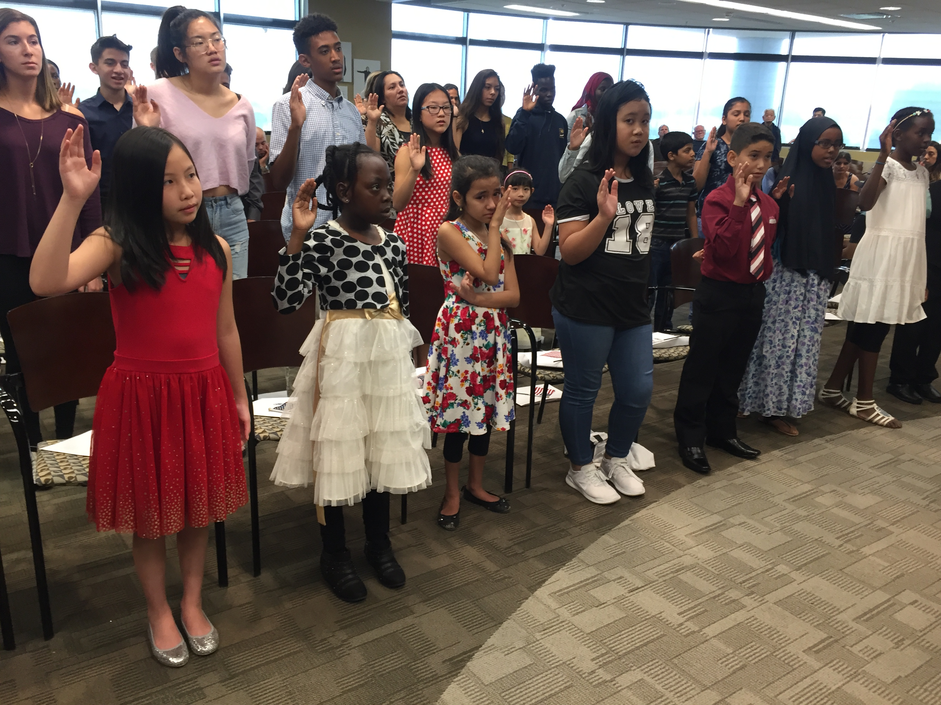 <p>More than 30 children, and a few grown-ups, from 18 countries received their citizenship certificates Aug. 24, 2018.</p>