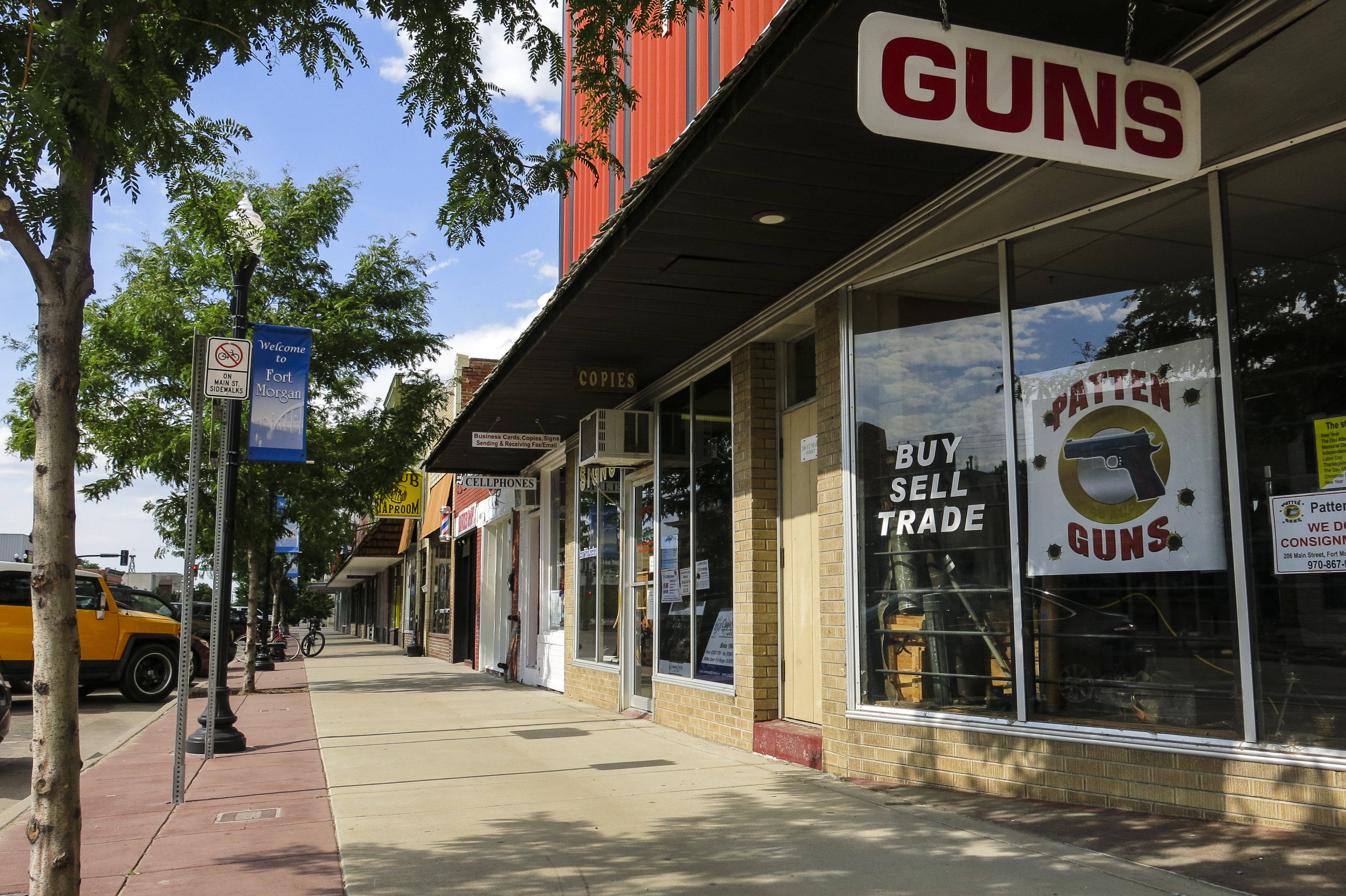<p>Patten Guns and other shops line Main Street in Fort Morgan, Colorado.</p>