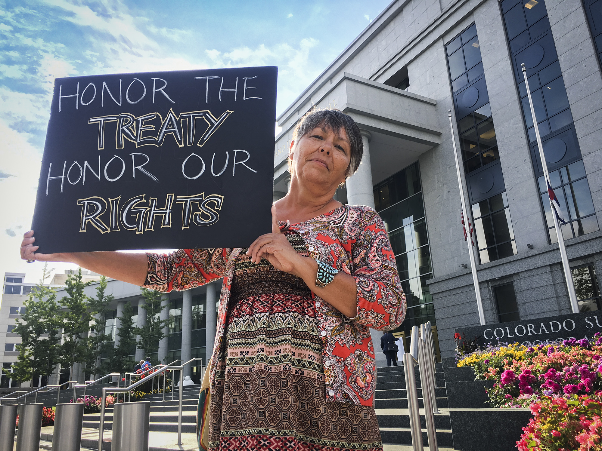 <p>Margaret Montaño from San Luis, Colorado, stands outside the Colorado Supreme Court and Court of Appeals building in downtown Denver. </p>