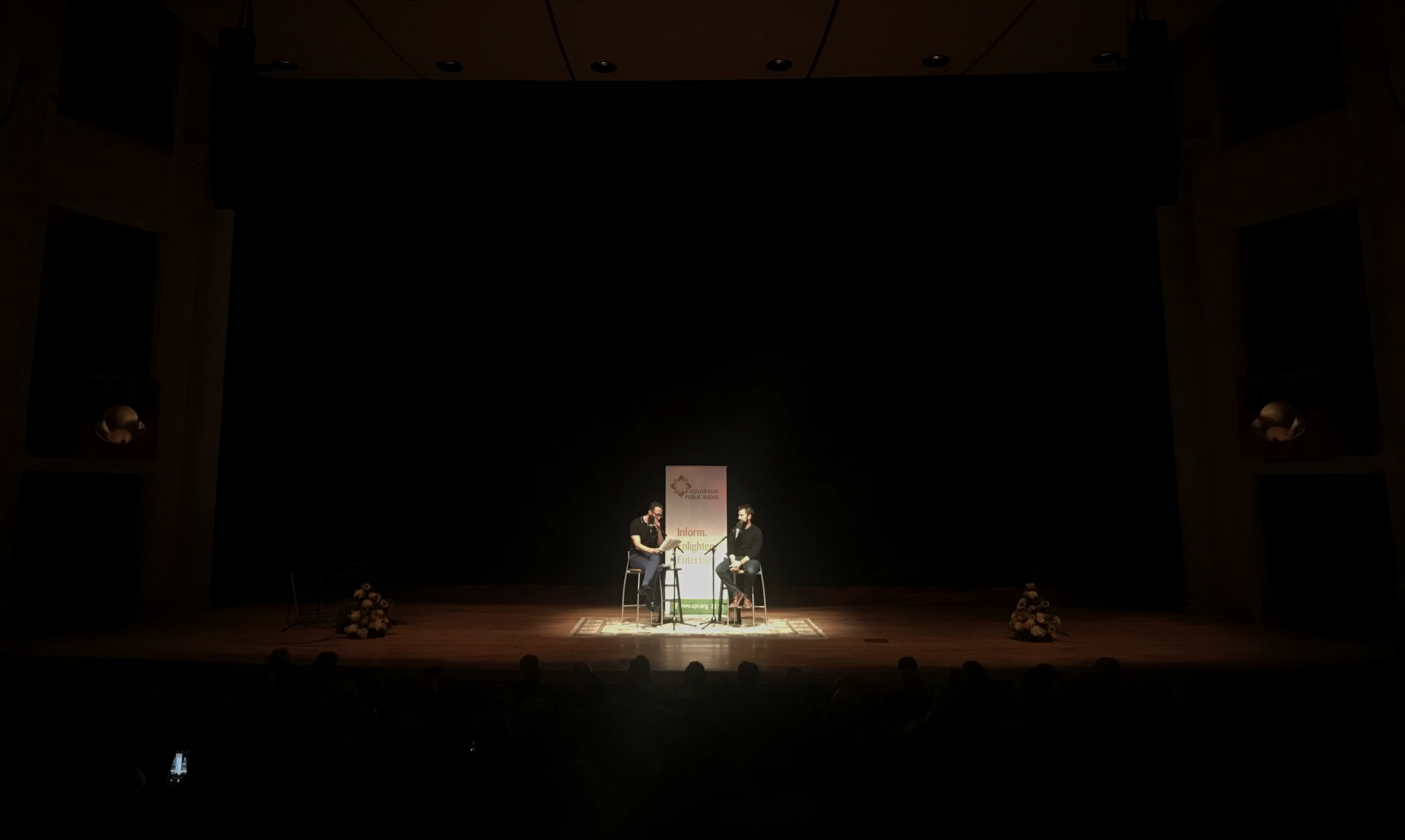 <p>Comedian Adam Cayton-Holland on stage with Ryan Warner at the Newman Center on Thursday, Sept. 13, 2018.</p>