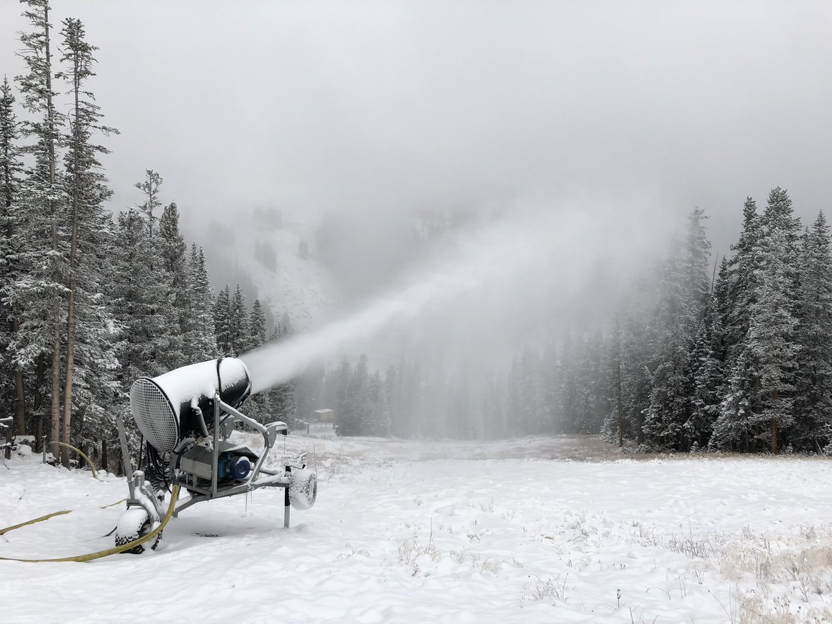 <p>A snowgunblasts out man-made snow at Loveland Ski Area on Monday, Oct. 8, 2018.</p>