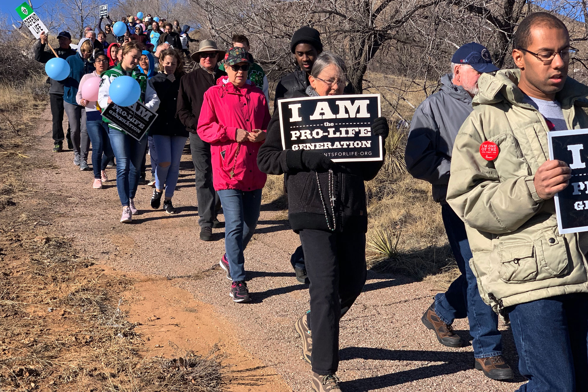 <p>Hundreds of anti-abortion activists hold signs and march in Colorado Springs on Monday, Jan. 21, 2019.</p>