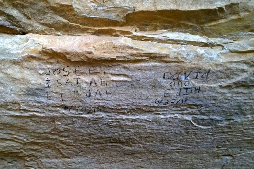 <p>Rangers found these names rubbed onto the sandstone using prehistoric charcoal dug up from an archaeological site along the Petroglyph Point Trail.</p>