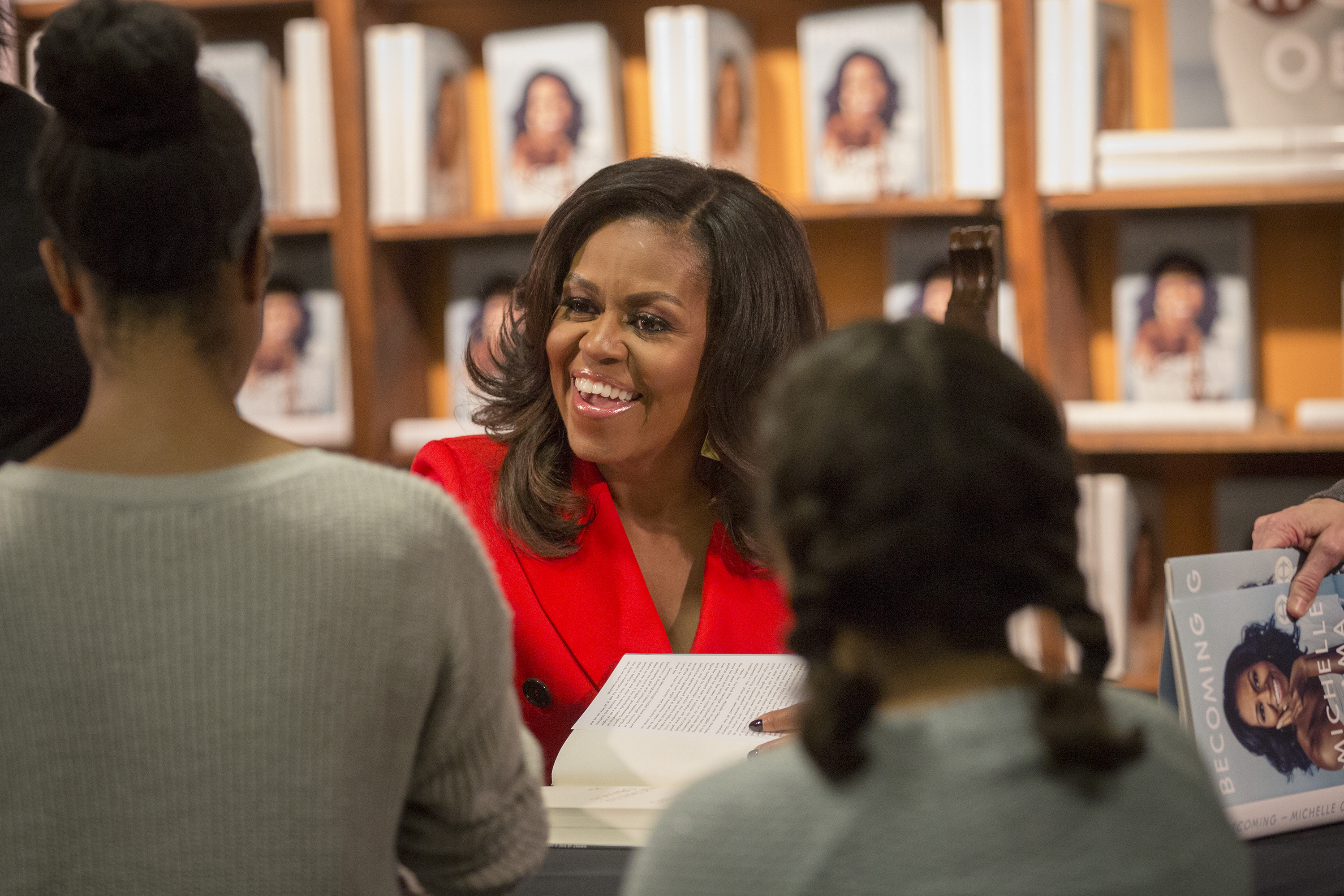 """<p>Former first lady Michelle Obama met folks and signed copies of her new memoir """"Becoming"""" at the Tattered Cover Bookstore on Colfax Avenue in Denver Thursday Dec. 13, 2018. The line stretched up from the lower level of the store all the up and around the main floor of the bookseller.</p>"""
