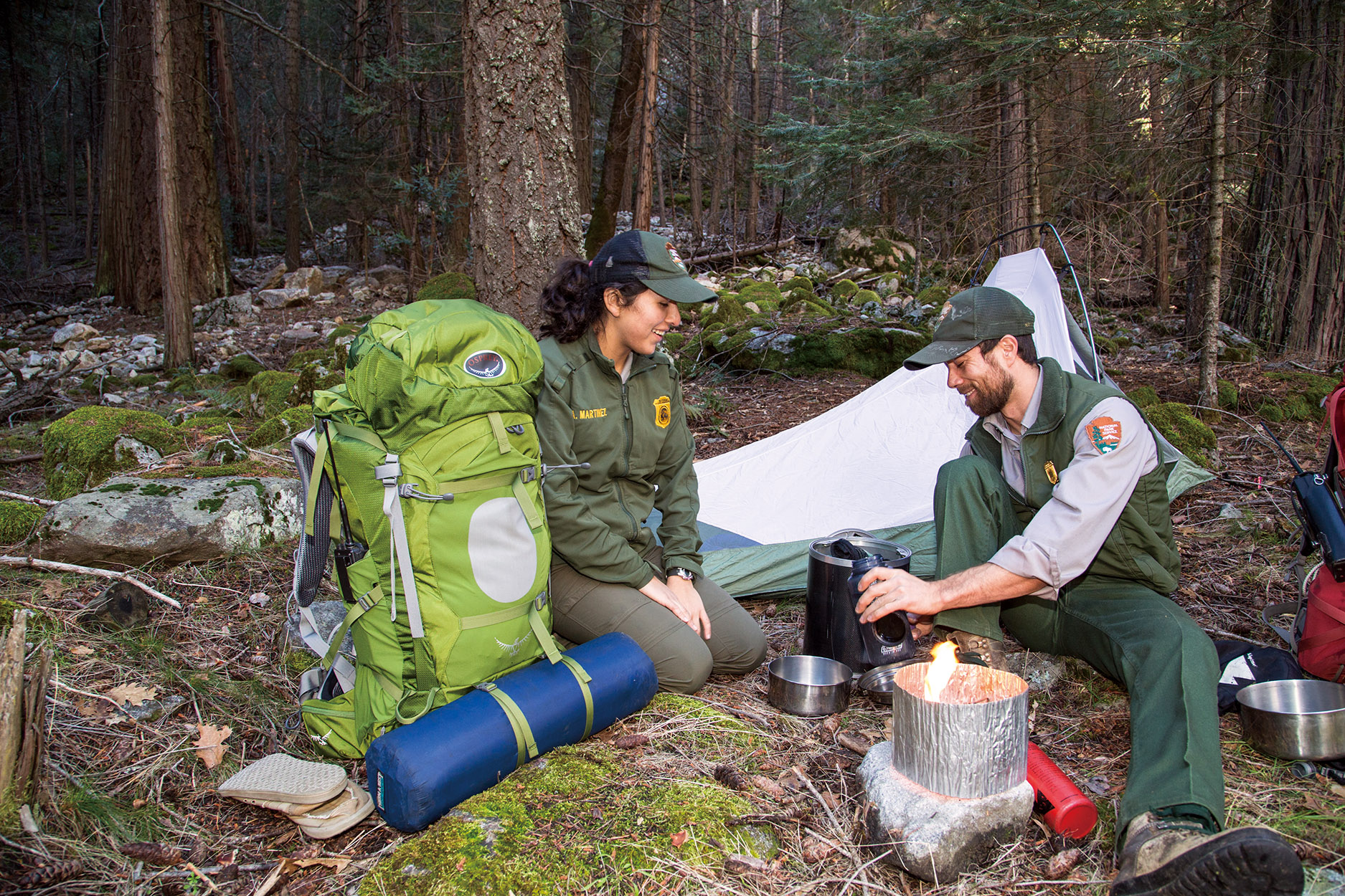 "<p>National Park Service rangers Africia Martinez <span style=""line-height: 1.66667em;"">(left) </span><span style=""line-height: 1.66667em;"">and </span><span style=""line-height: 1.66667em;""> Jesse Chakrin </span><span style=""line-height: 1.66667em;"">(right) make dinner. </span></p>"
