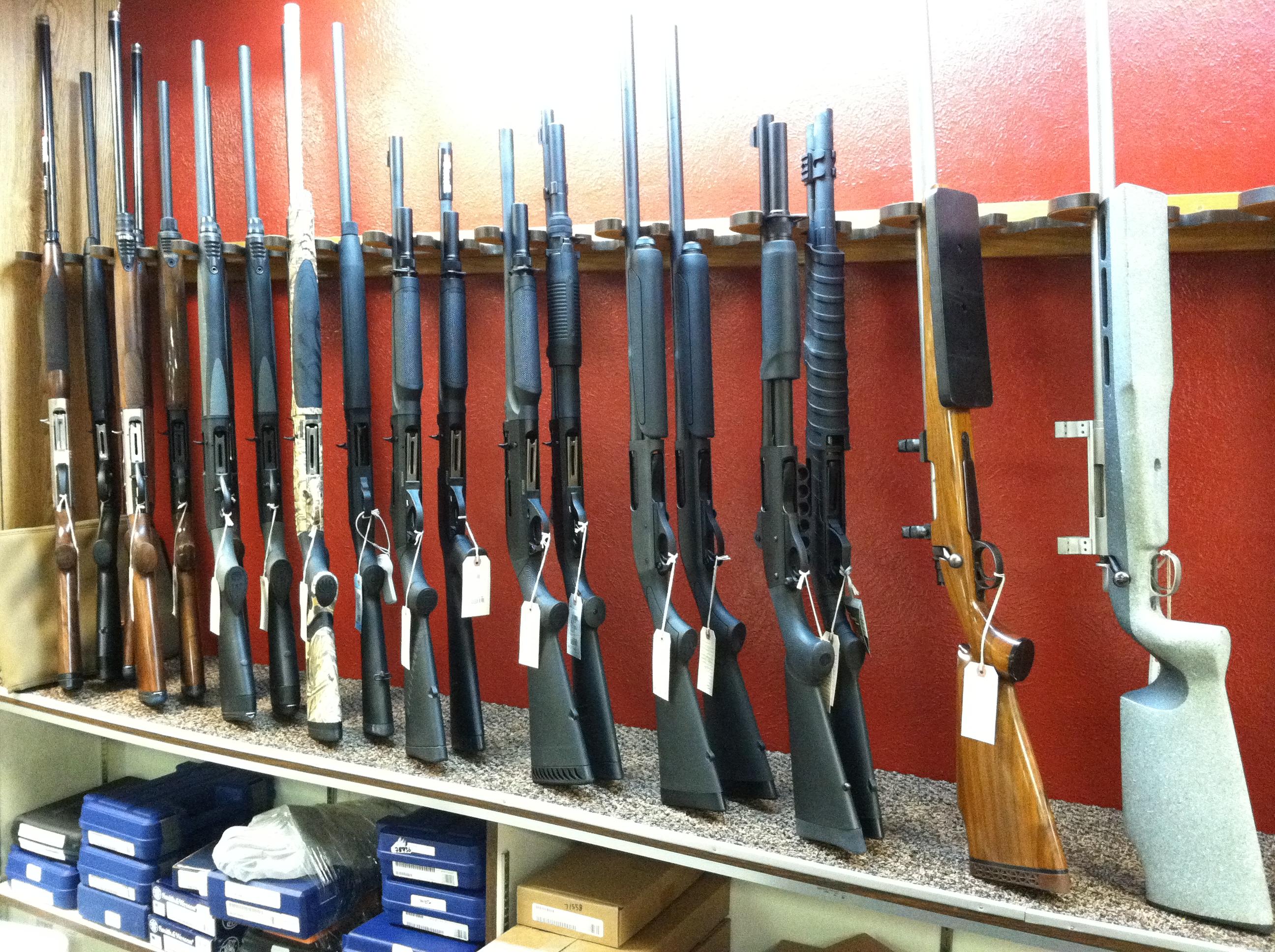 Photo: Rifles on display at an Aurora gun shop.
