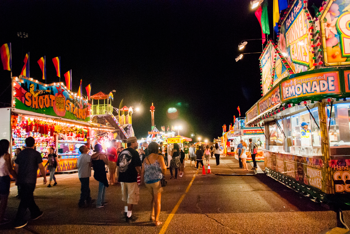 <p>The Colorado State Fair carnival lights up as night falls over Pueblo.</p>