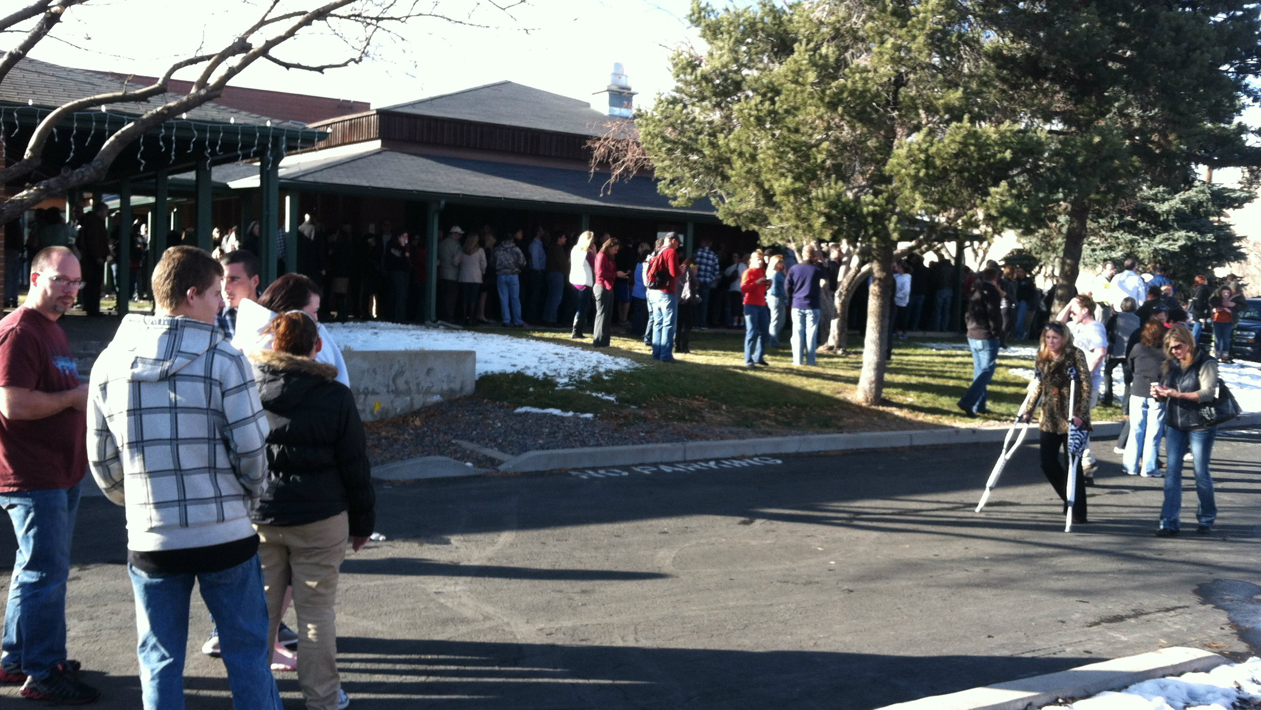 Photo: Parents outside church after Arapahoe High School shooting.