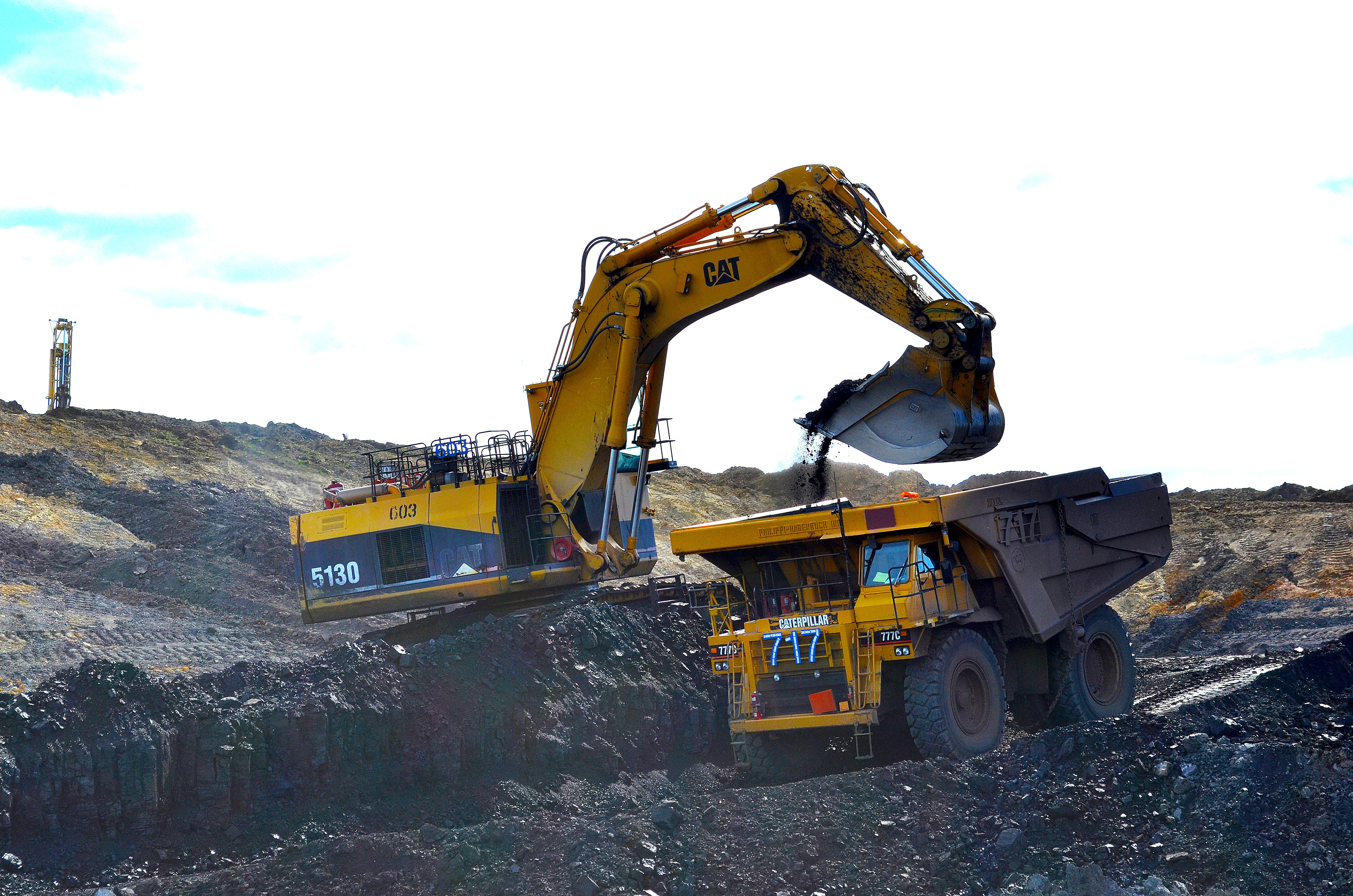 <p>A backhoe dumps coal into a haul truck at Trapper Mine near Craig, Colo. The coal is taken to a crusher behind Craig Station, a coal-fired power plant, to begin the process of turning it into energy.</p>