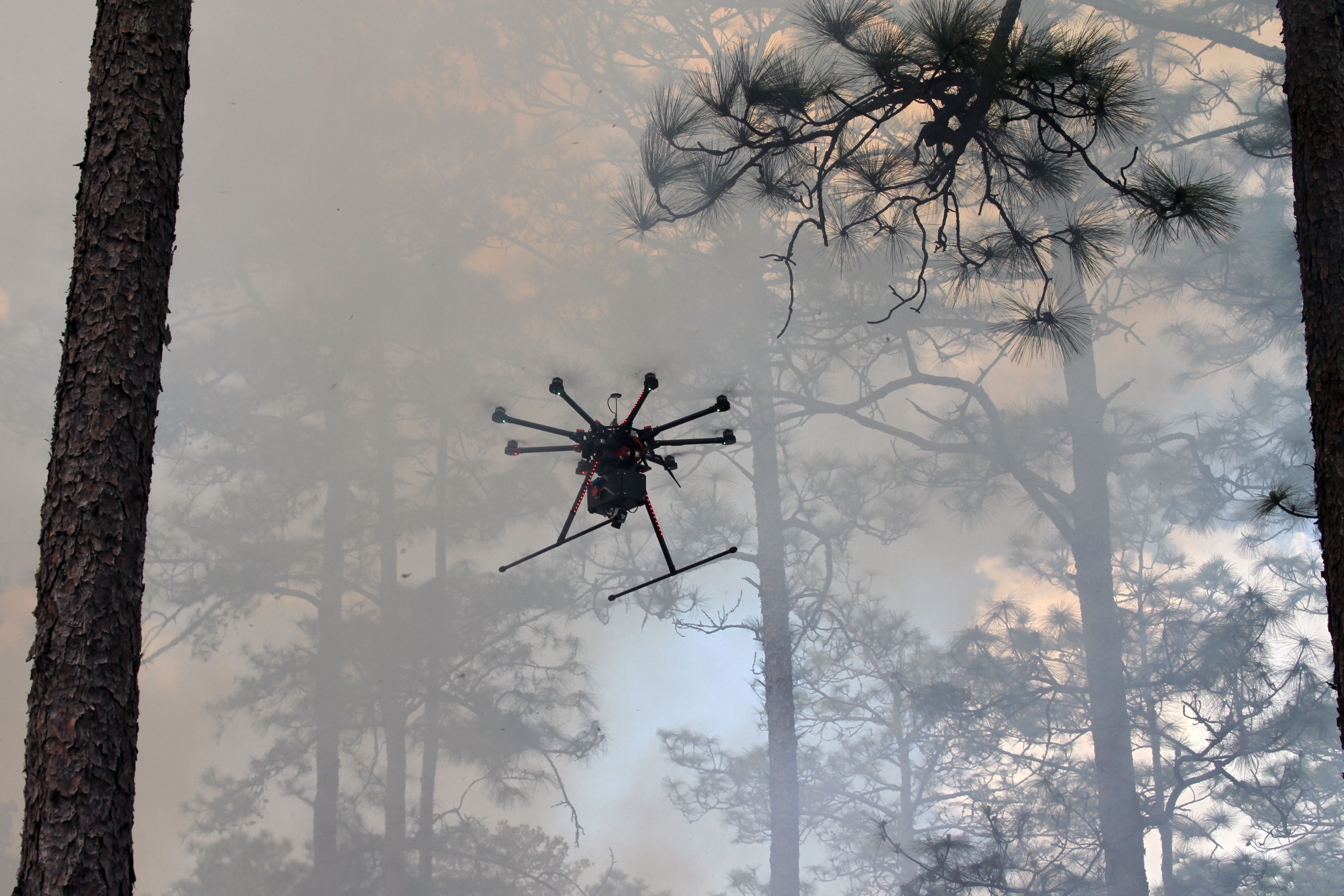 <p>A drone flies into a smoke plume at a U.S. Geological Surveytall timbers research station, November 2000.</p>