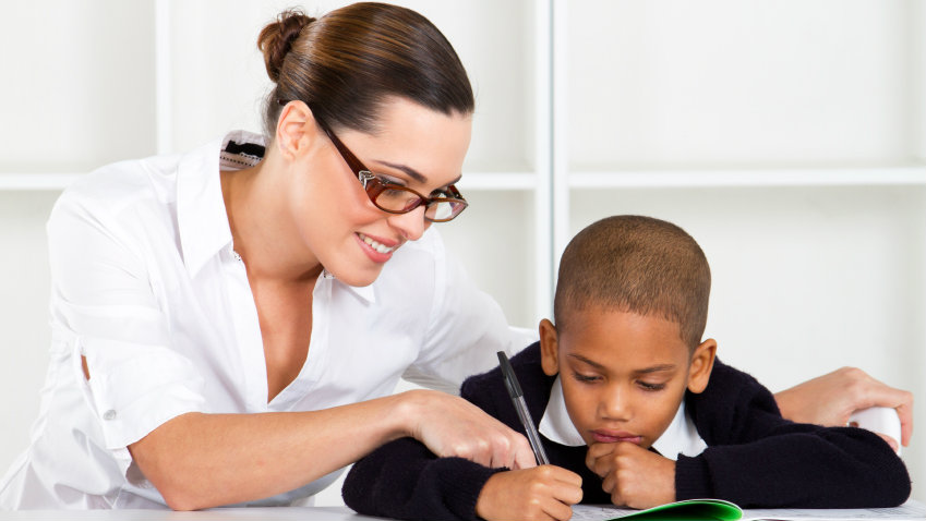 Photo: White teacher, student of color (iStock)
