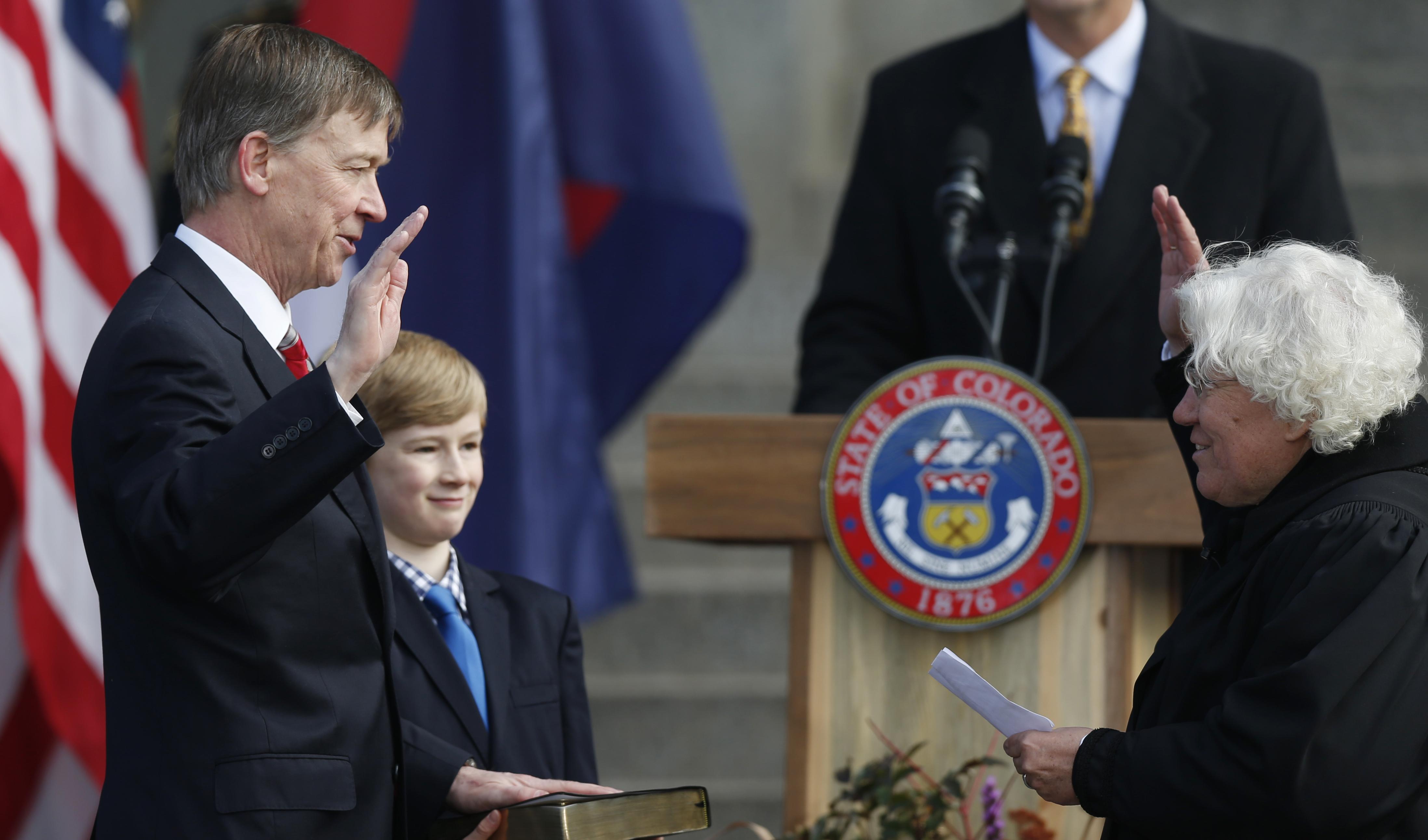 Photo: Gov. John Hickenlooper sworn in (AP Photo)