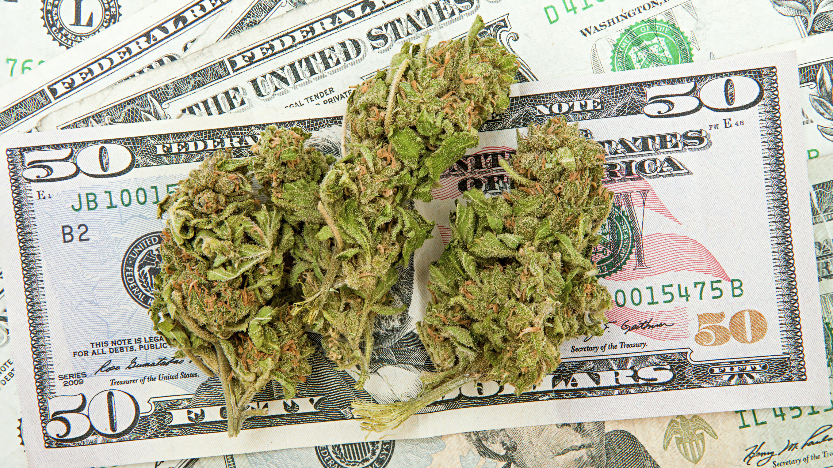 Photo: Marijuana money (iStockphoto)