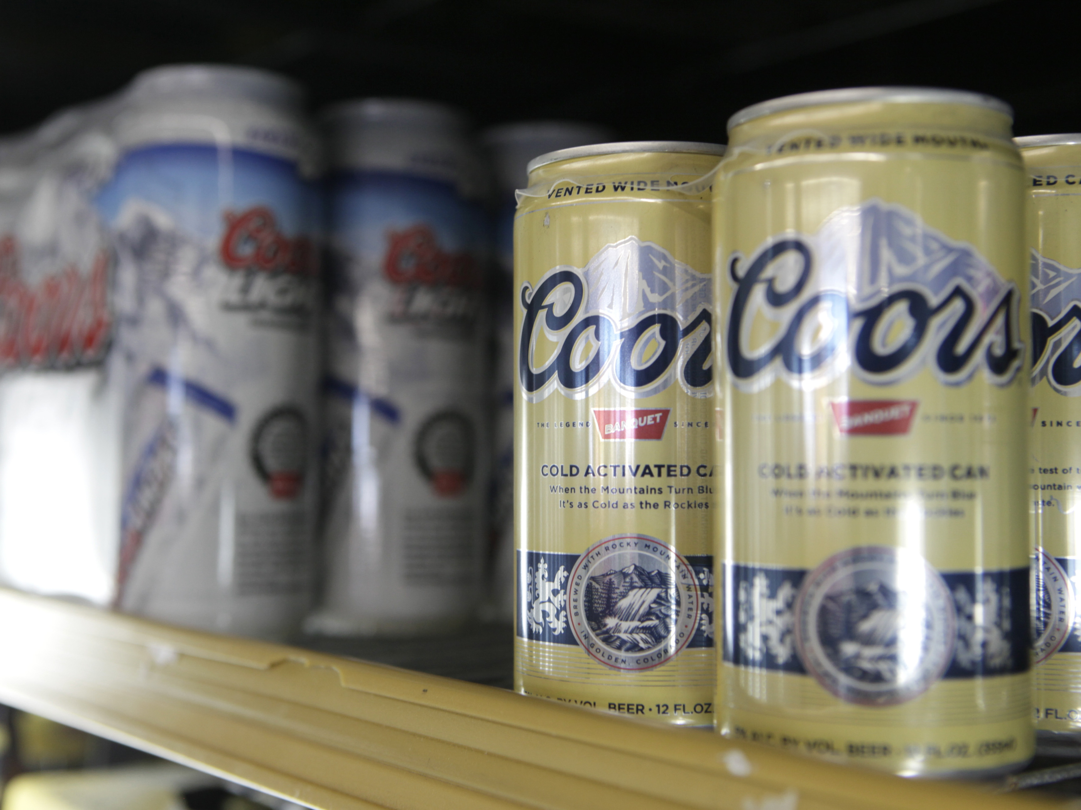 Photo: Cans of Coors beer