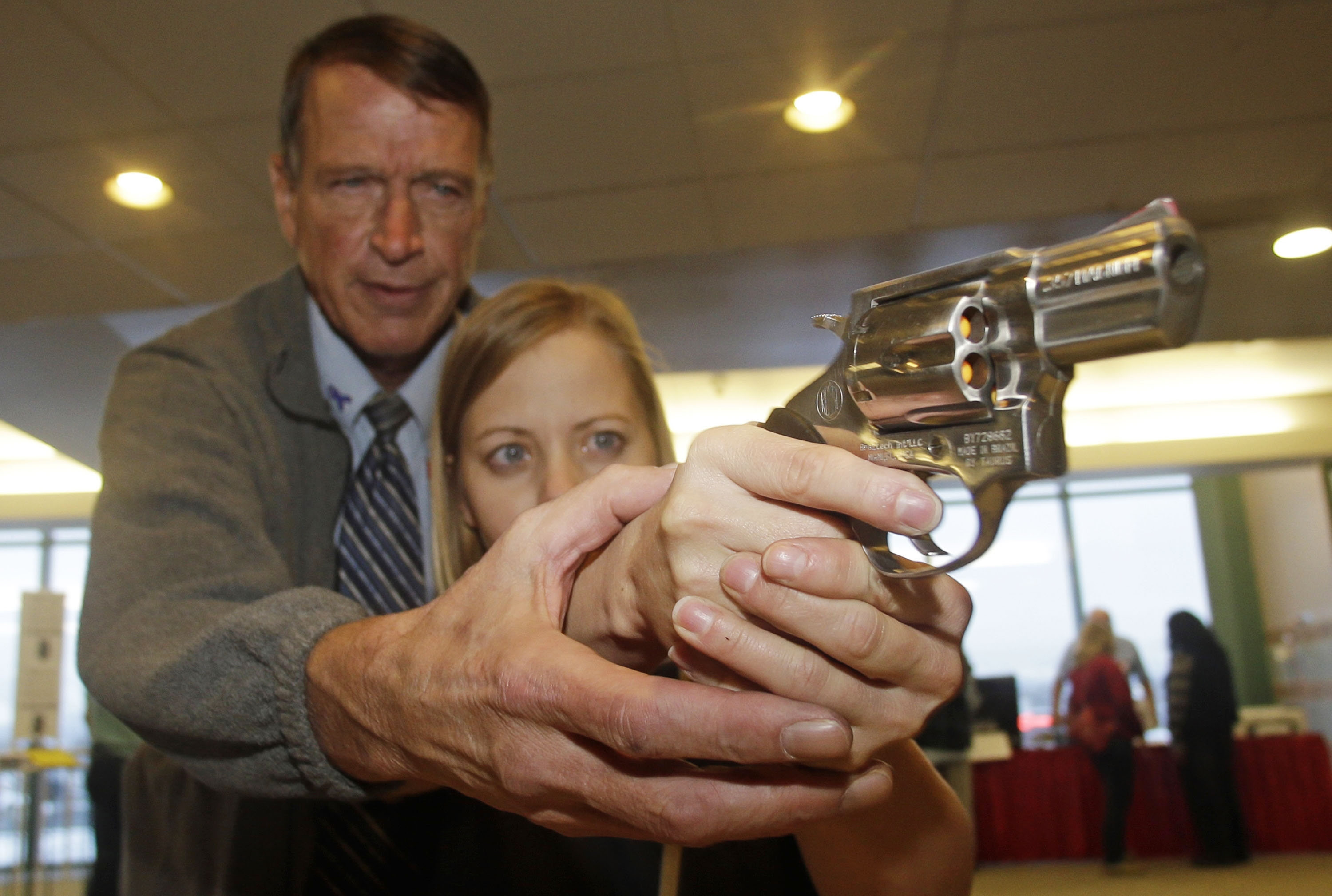 Photo: Teacher with gun (AP Photo)