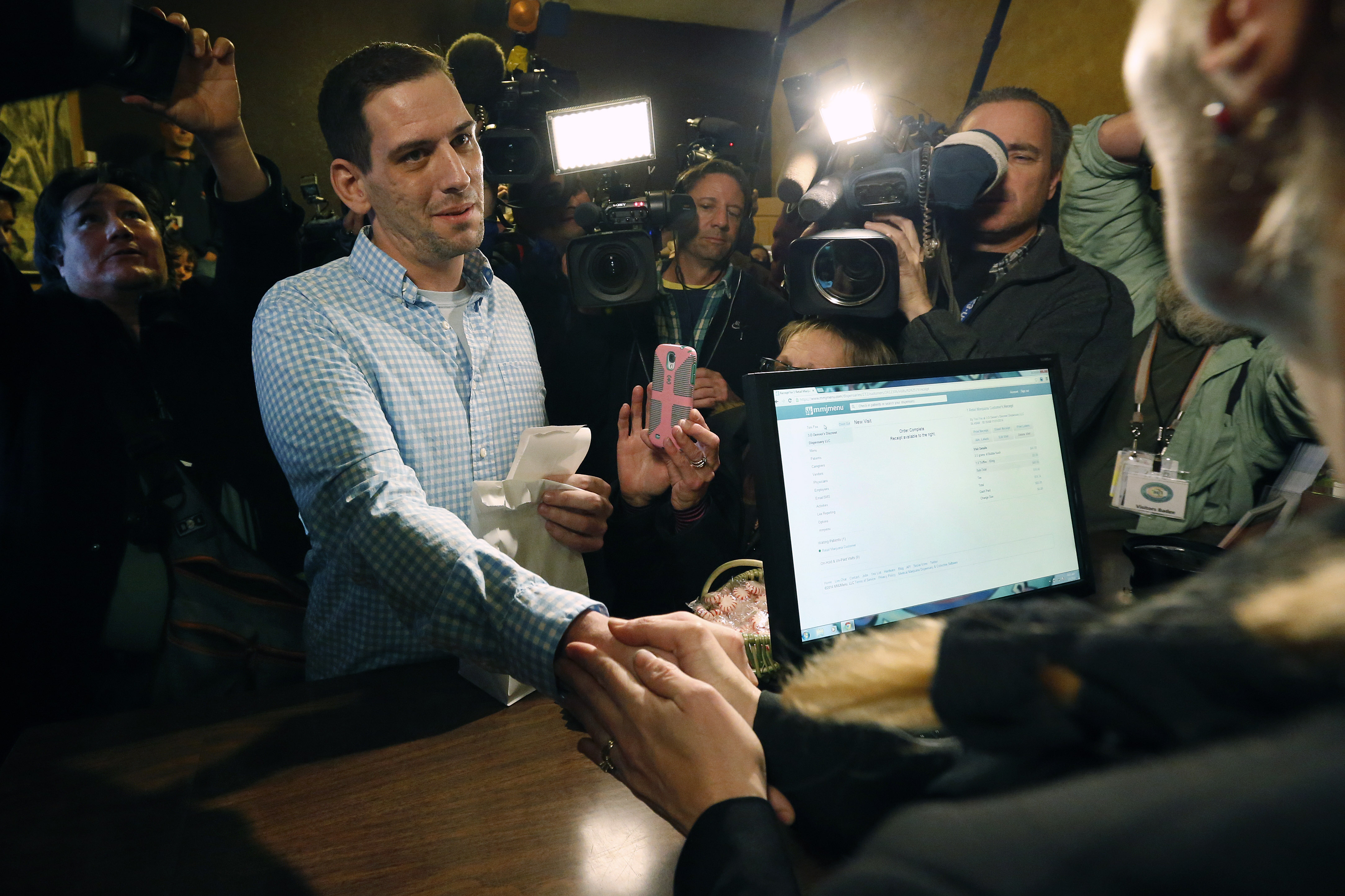 Photo: First legal retail marijuana sale (AP Photo)
