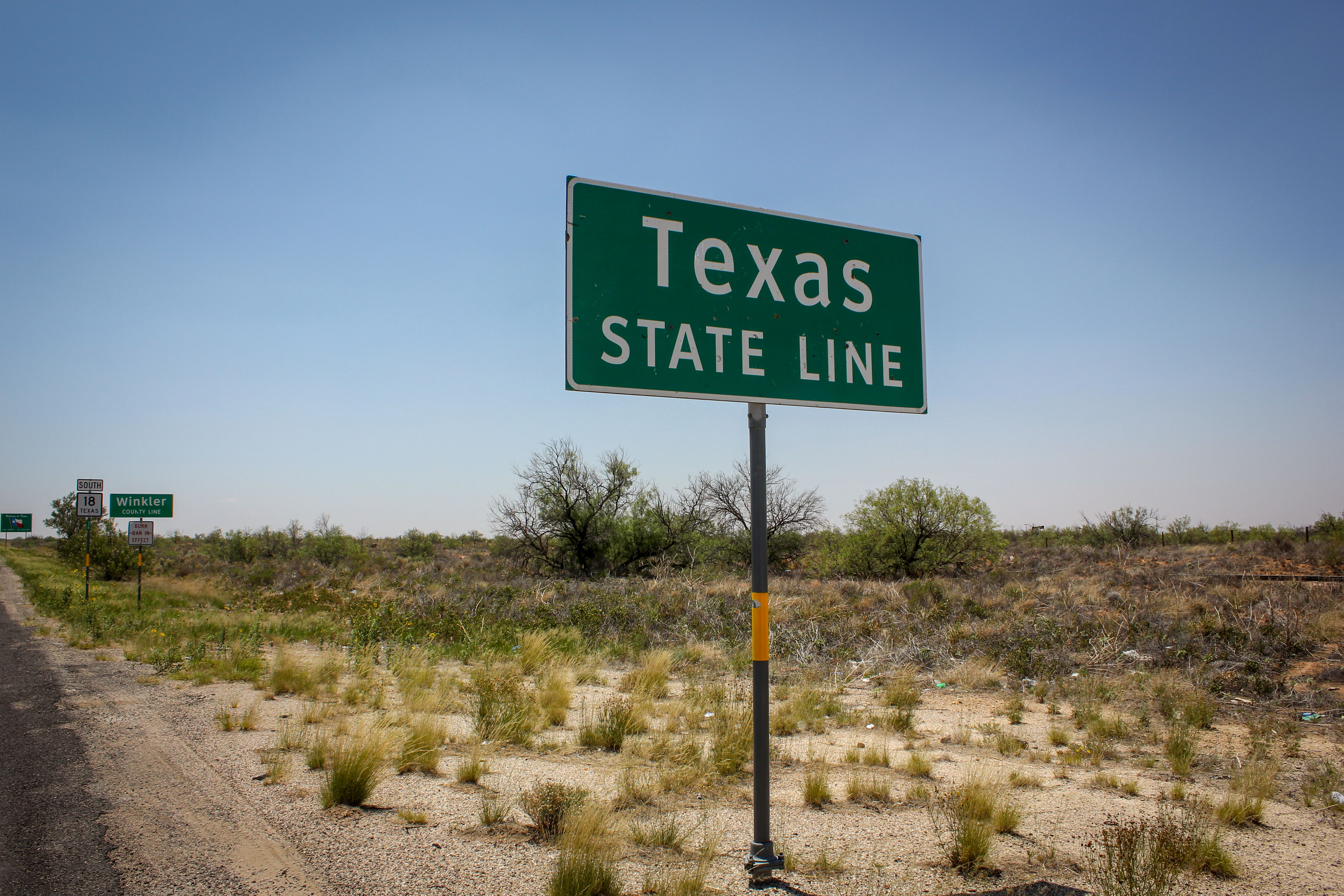 Photo: Denver Texas Climate | Texas-New Mexico State Line Sign - CC/Flickr