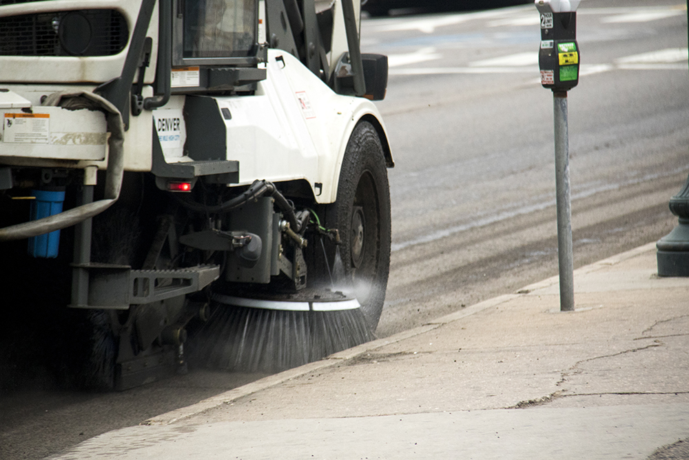 <p>A street sweeper gives a (probably much needed) clean of Colfax Avenue.</p>